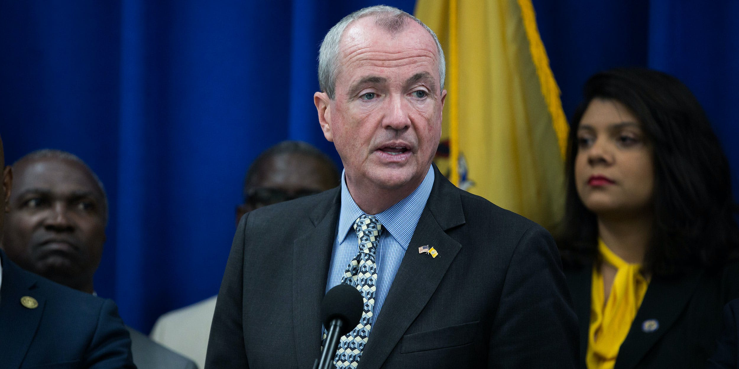 Phil Murphy, governor of New Jersey, speaks while Ras Baraka, mayor of Newark, left, listens during a budget press conference in Newark, New Jersey, U.S.