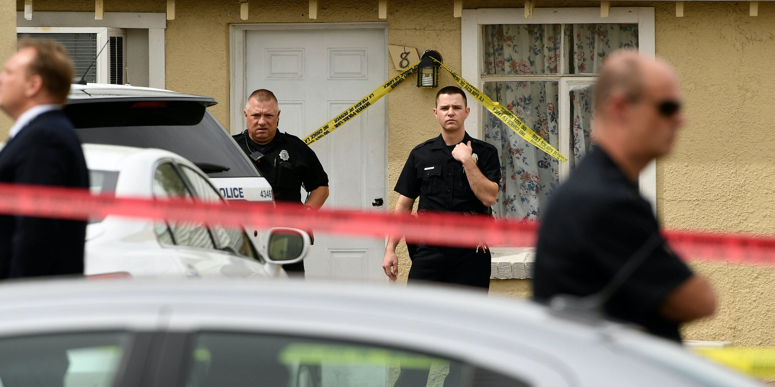 Officers guard a motel at the scene of a shooting in 2016. A new studysuggests that police are solving more serious crimes, like this one, in Colorado and Washington since cannabis legalization.