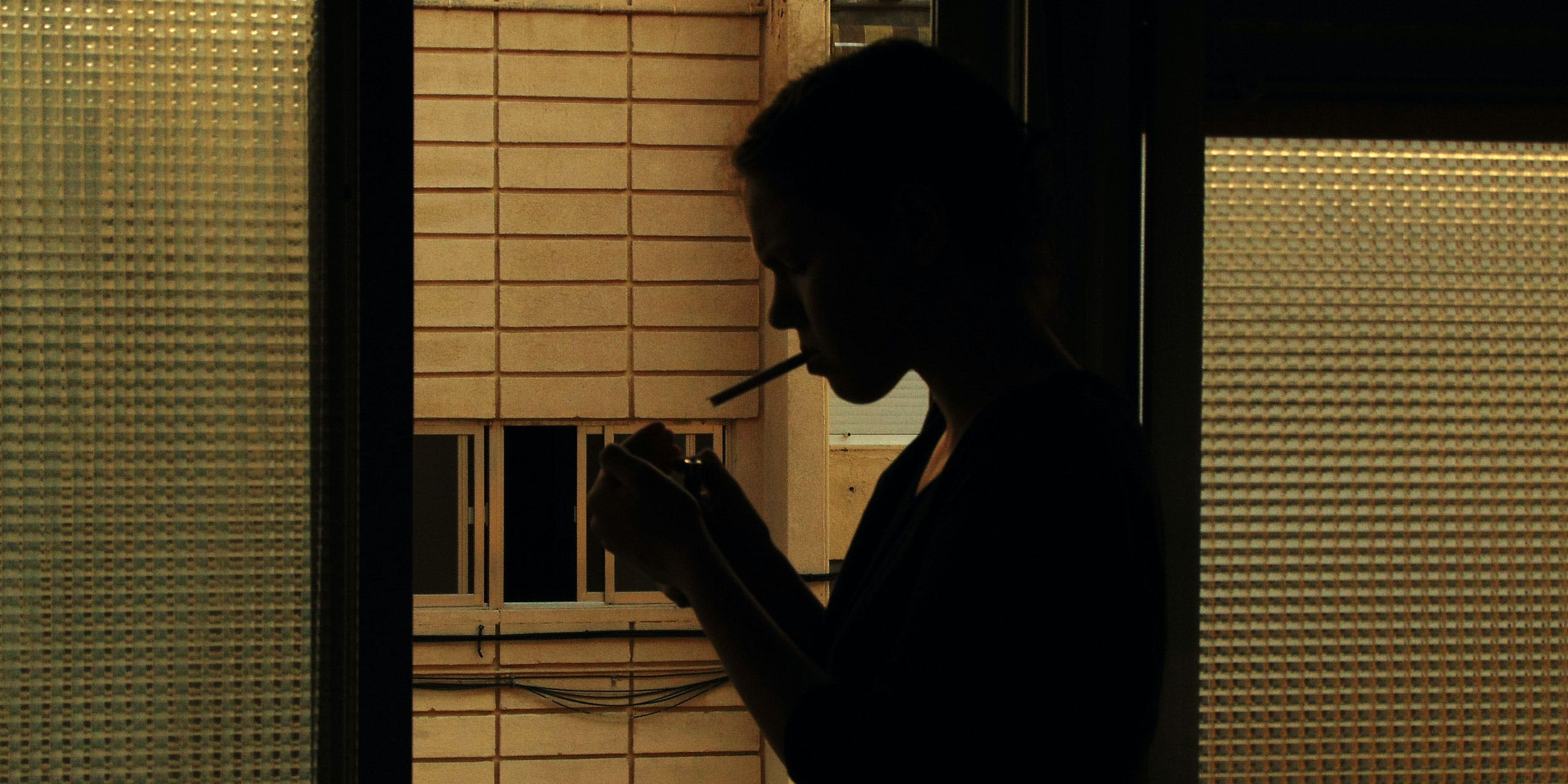 Woman sues sodexo for firing her for recreational cannabis use. Here, a woman is seen smoking at night