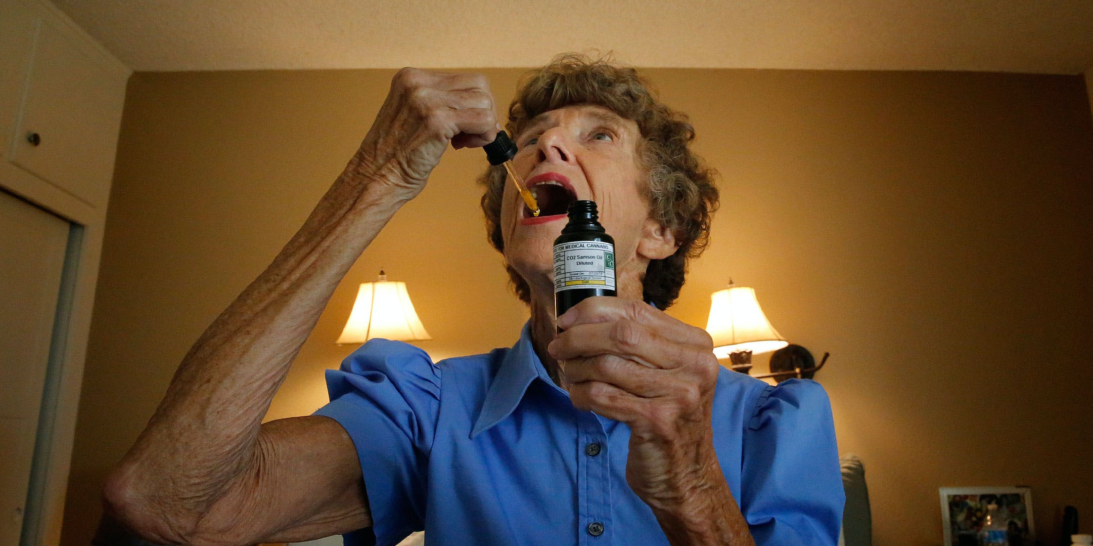A senior takes a drop of medical marijuana under her tongue to help with pain relief. A recent Northwell survey found that 27 percent of seniors were able to forgo other forms of pain medication after using cannabis.