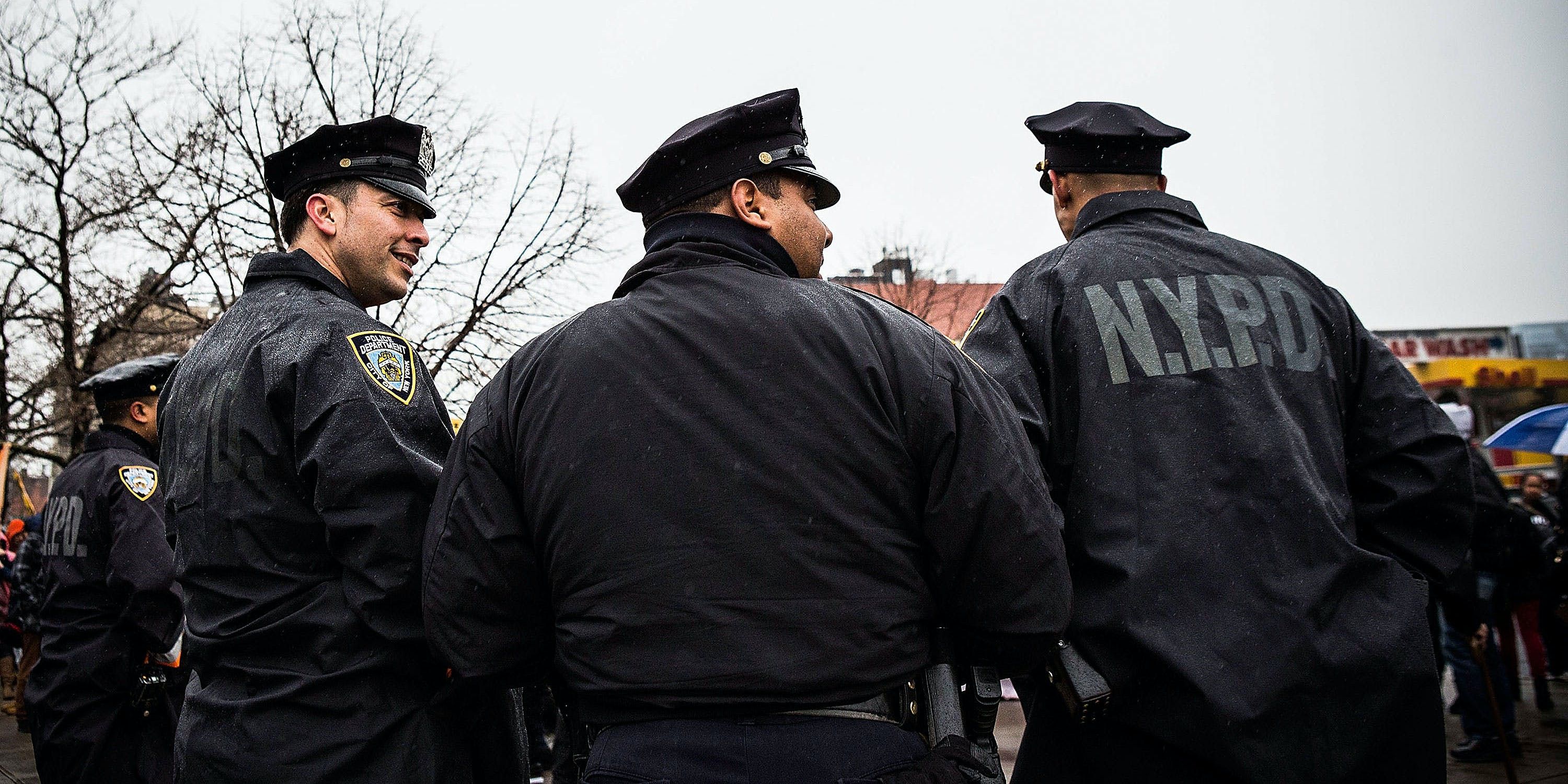 NYPD officers monitor a march against stop-and-frisk tactics used by police on February 23, 2013 in New York City. The march, which consisted of a few hundred people, started in the Bronx borough of New York and marched into the Harlem neighborhood of Manhattan. (Photo by Andrew Burton/Getty Images)