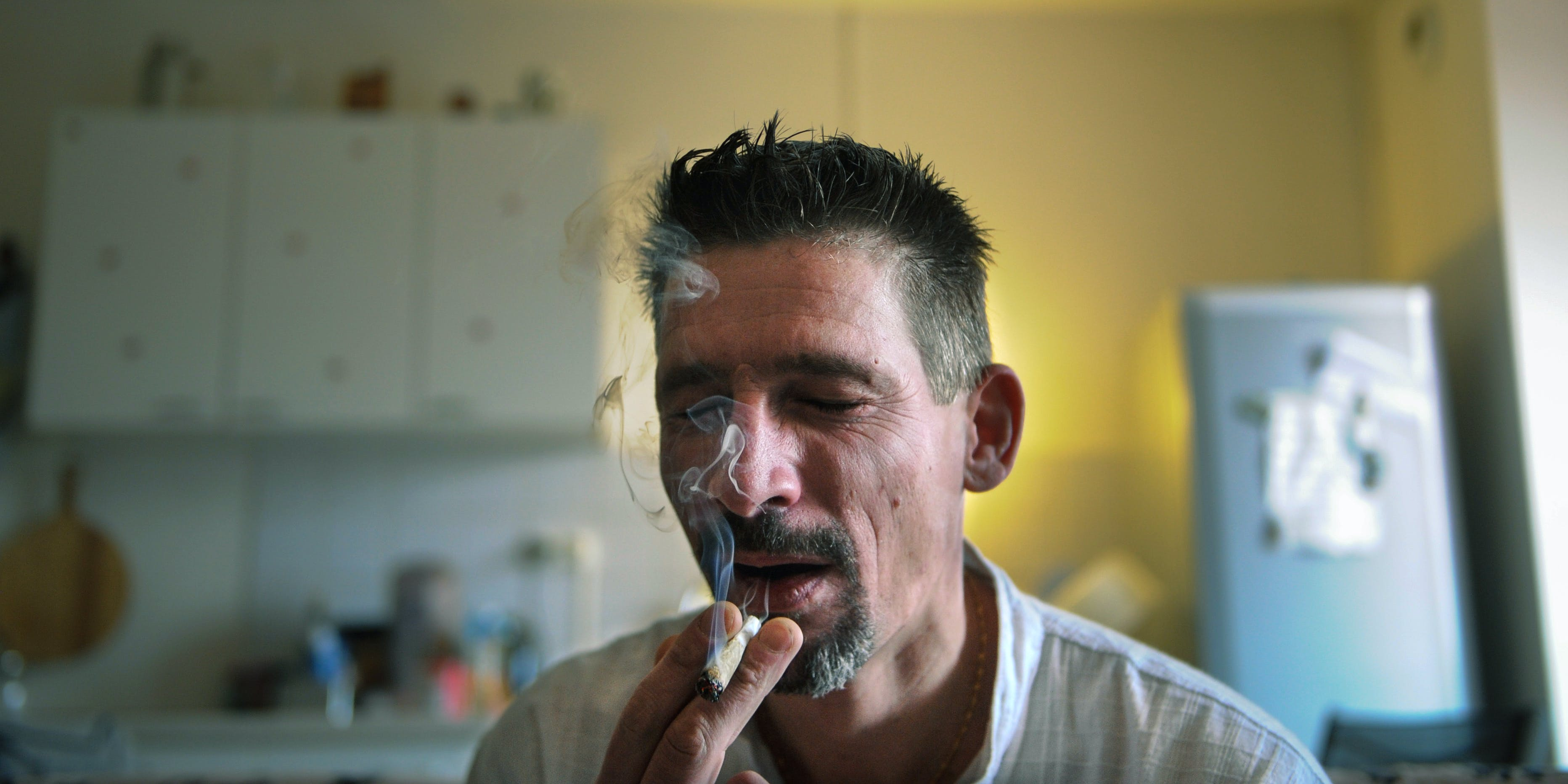 Dominique Loumachi, suffering from Dermatomyositis (Myopathy), smokes a cigarette that looks like a cannabis cigarette - in order not to be charged for promoting consumption of narcotic substances - while posing on February 28, 2013 in Belfort, Eastern France. Some medical marijuana patients prefer cannabis in smokeable form, but that hasn't prevented some states, like Oklahoma, from banning it.
