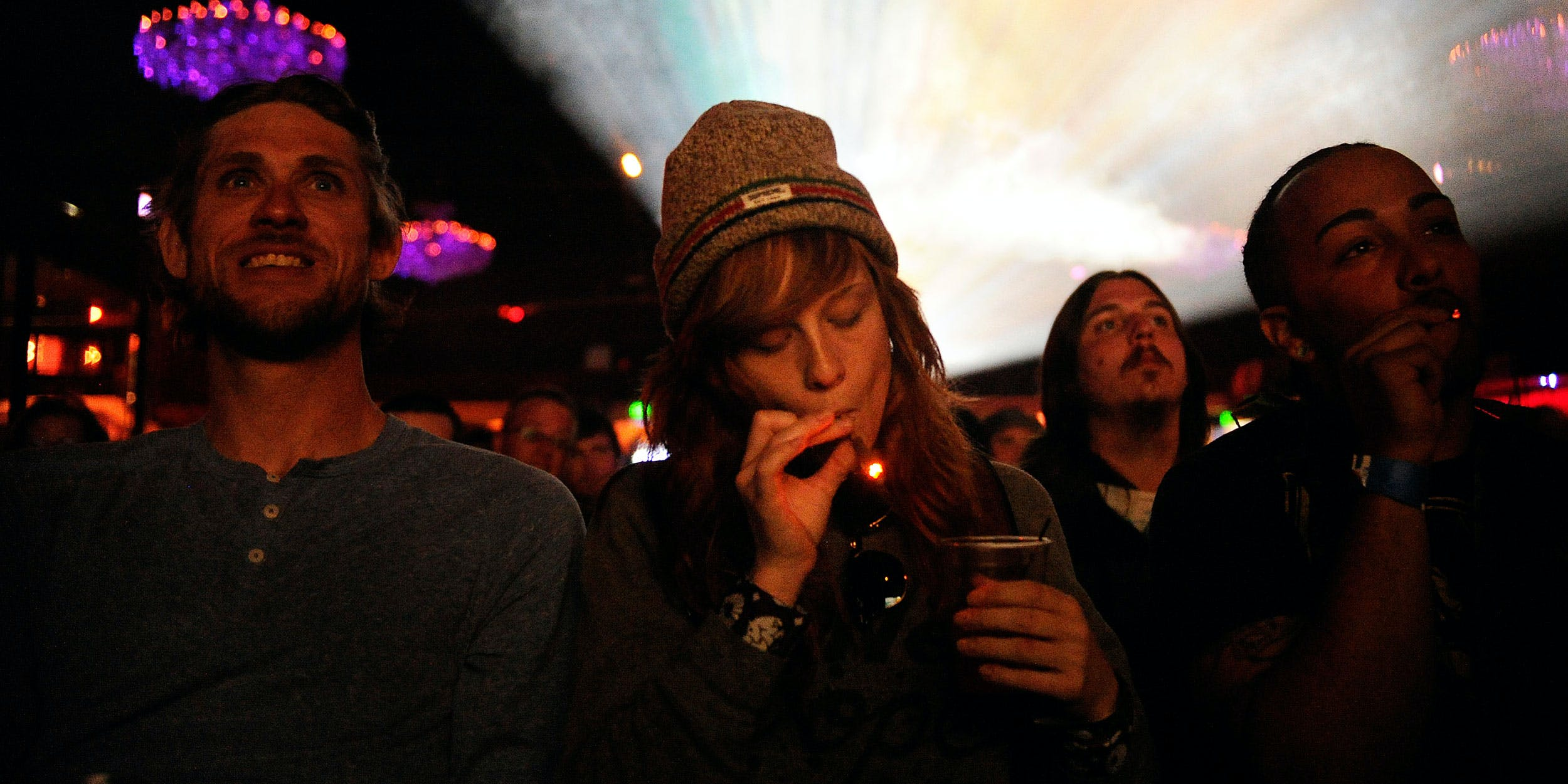 """Caiti Beckwith of Denver, Colorado smokes a joint while watching the Snoop Lion documentary Reincarnated during the first ever """"Green Carpet"""" event as a part of the High Times US Cannabis Cup at the Fillmore Auditorium on April 19, 2013 in Denver, Colorado. While cannabis is legal in Colorado and other states, it's still not permitted at most events. Outside Lands in California just announced it will be welcoming Cailfornia's cannabis industry with an education section called """"Grass Lands."""""""