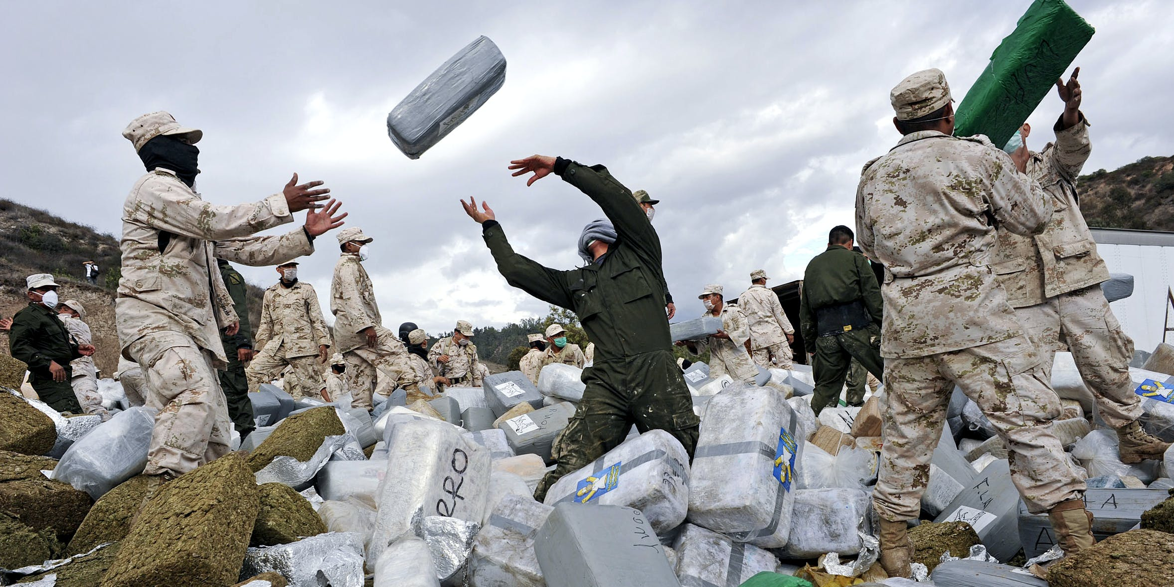 Mexican soldiers unload bundles of seized marijuana before incinerating the drugs at a military base in Tijuana, Mexico, on Wednesday, Oct. 20, 2010. Authorities carried out the biggest marijuana bust in Mexico's history this week when approximately 134 tons of marijuana headed for the U.S. was confiscated by soldiers and police. Mexico has impounded more than 7,400 tons of marijuana this year as part of President Felipe Calderon's fight against drug cartels.
