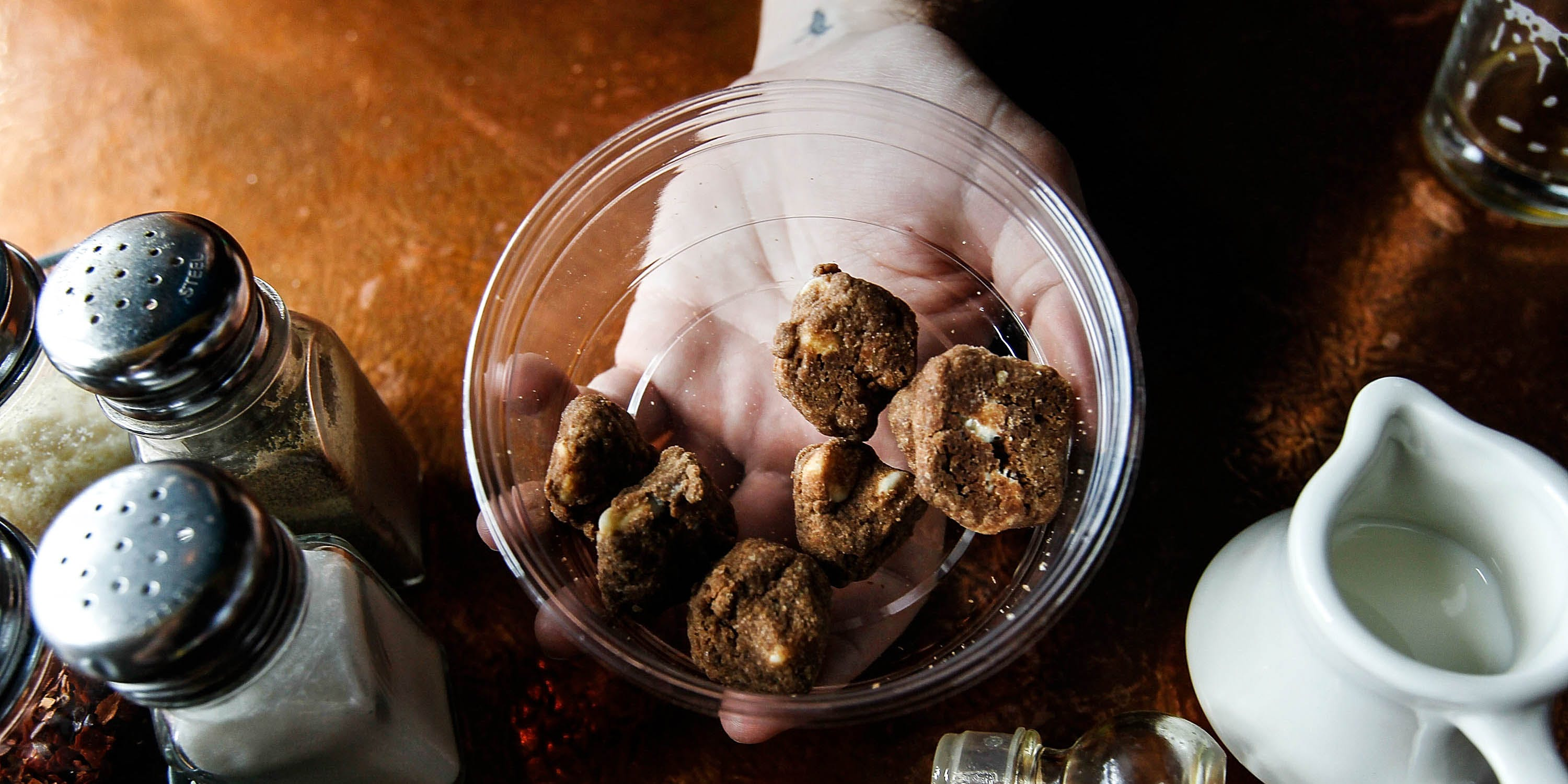 "Marijuana-infused cookies called ""Medibles"" are displayed at the Cannabis Crown 2010 exp. According to a recent report by the CBC, potent edibles paired with poor public education have caused a spike in emergency room visits."