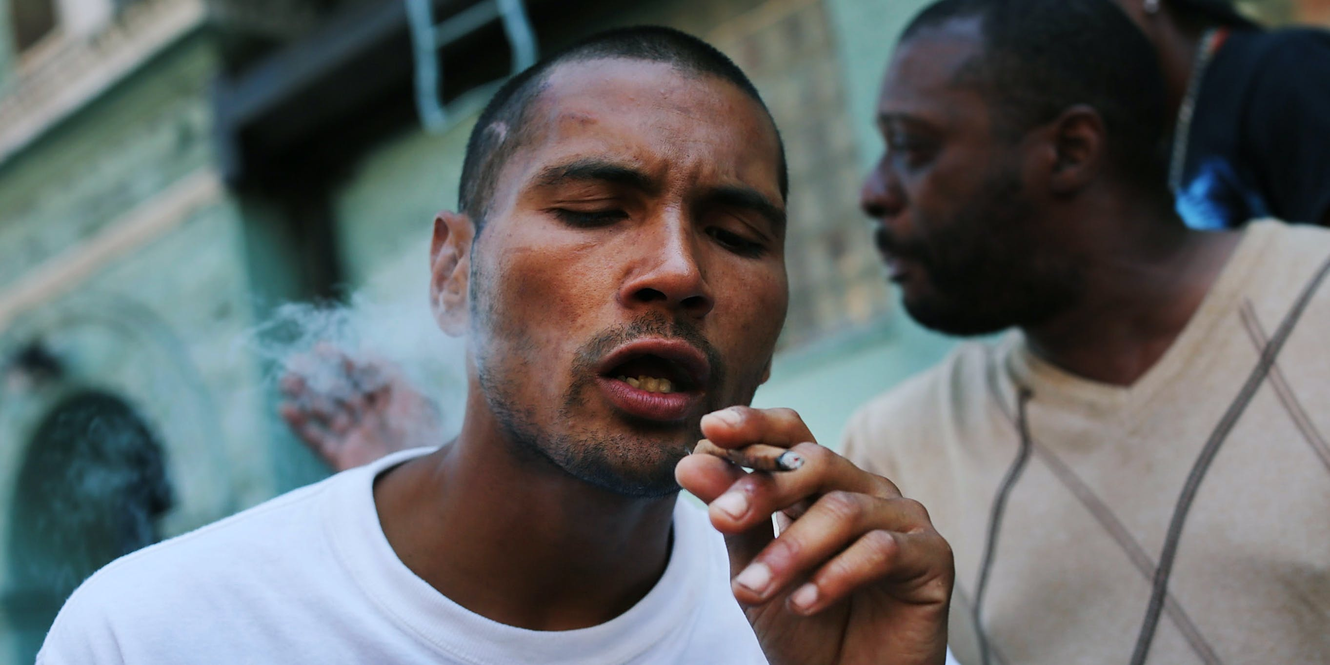 """NEW YORK, NY - AUGUST 05: A man smokes K2 or """"Spice"""", a synthetic weed drug, along a street in East Harlem on August 5, 2015 in New York City. New York, along with other cities, is experiencing a deadly epidemic of synthetic marijuana usage including varieties known as K2 or """"Spice"""" which can cause extreme reactions in some users. (Photo by Spencer Platt/Getty Images)"""