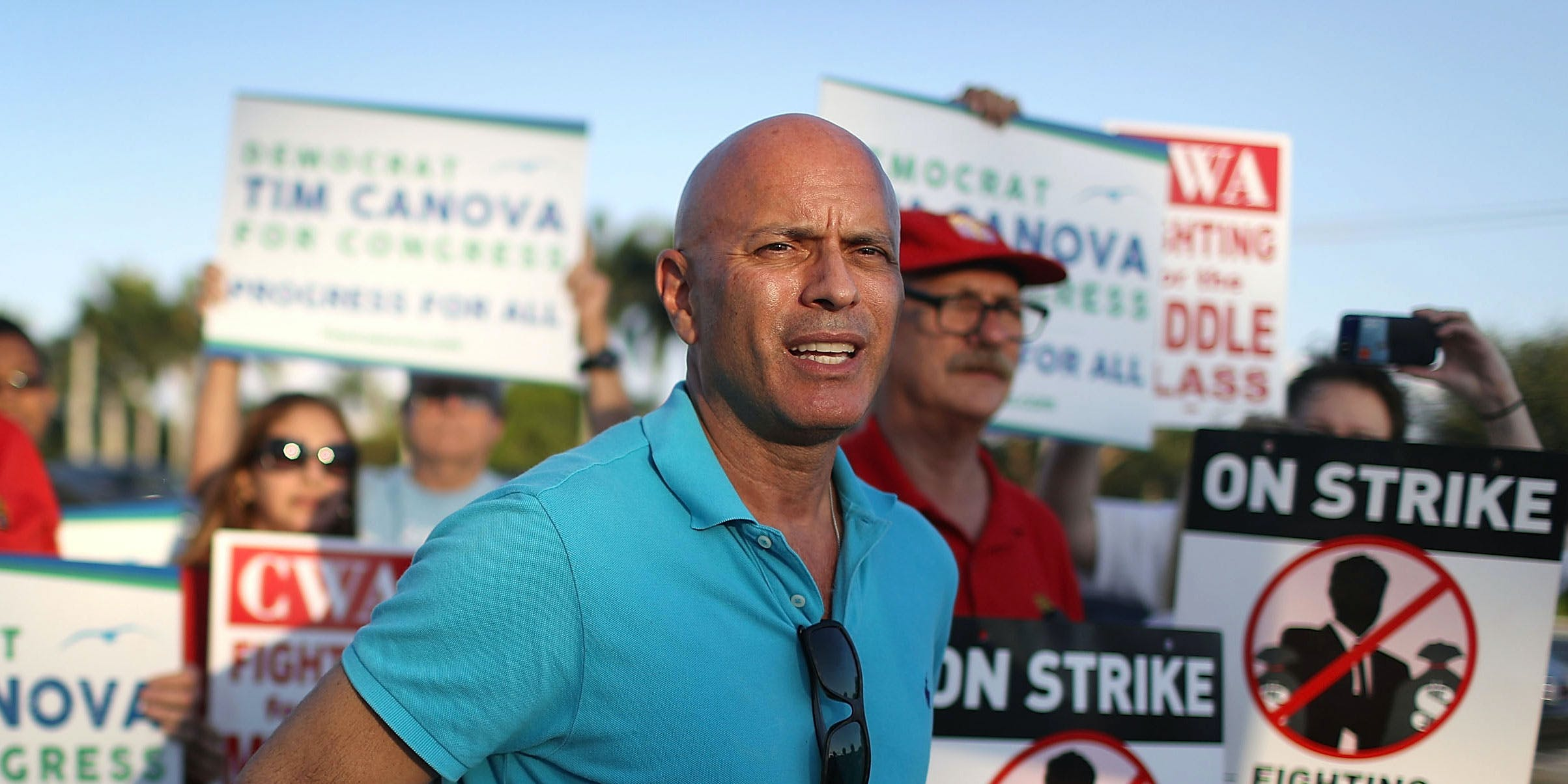 Tim Canova, Democrat Congressional Candidate for FL-23, joins CWA members, other South Florida union members and community activists at a Verizon protest on May 25, 2016 in Pembroke Pines, Florida. (Photo by Joe Raedle/Getty Images)