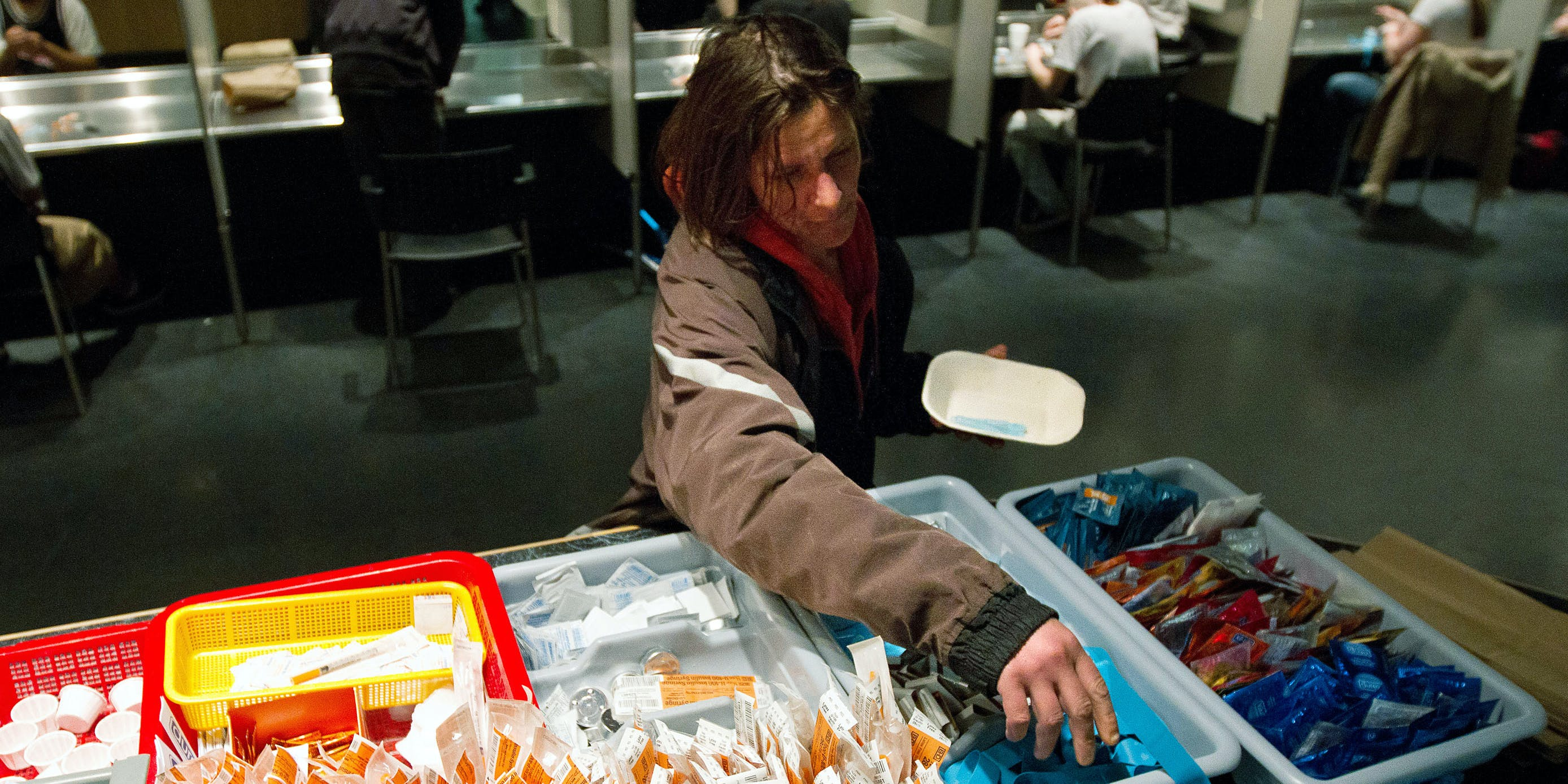 A client of the Insite supervised injection Center in Vancouver, Canada collects her kit on May 3, 2011. Toronto Public Health is currently calling on Canada to decriminalizes all drugs. (Photo by Laurent Vu The/AFP via Getty Images)