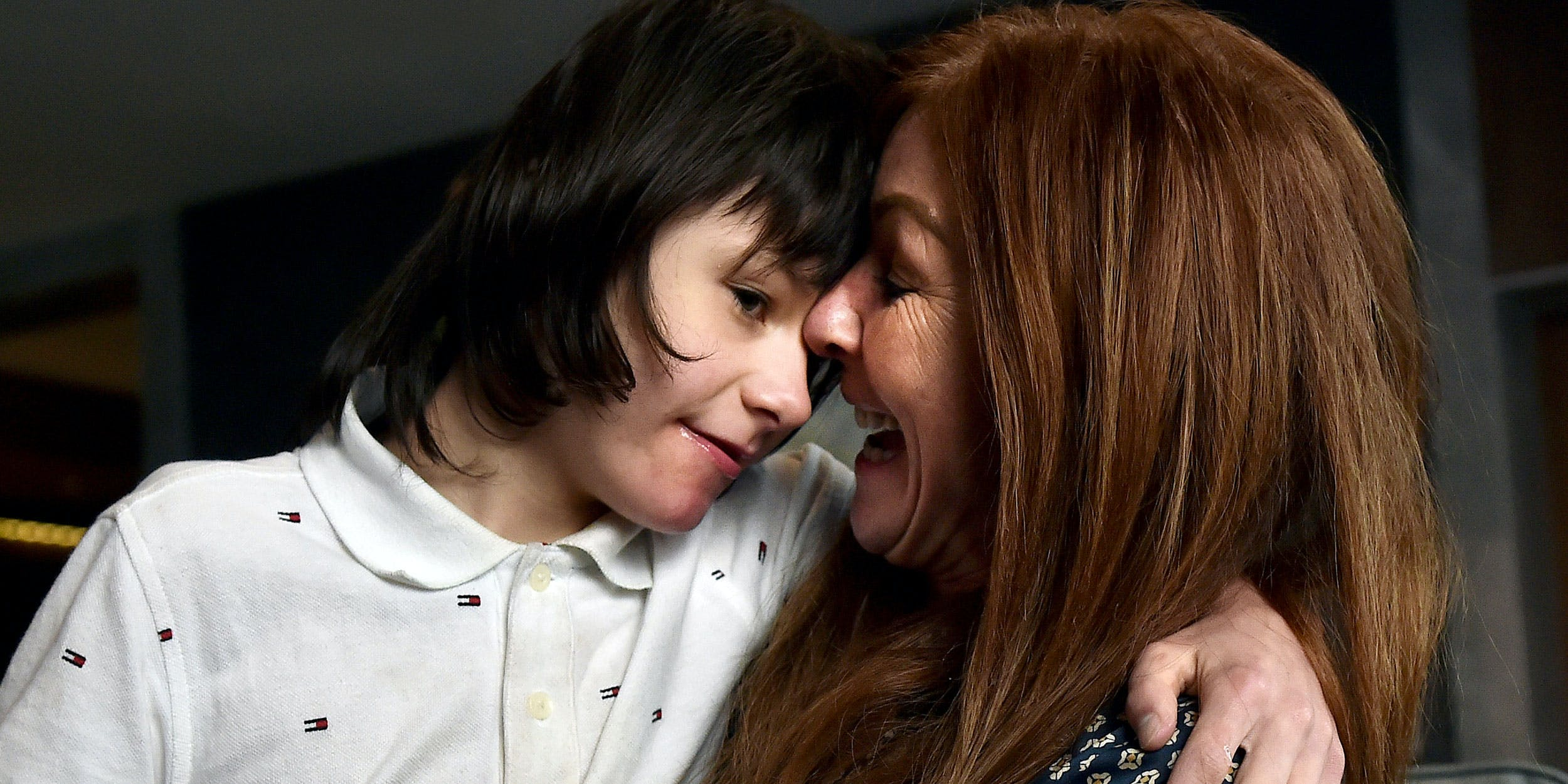 Billy Caldwell and his mother Charlotte as they return to Belfast on July 5, 2018. Billy's story about CBD for epilepsy spurred a debate in the UK about whether medical cannabis should be legal for prescription. (Photo by Charles McQuillan/Getty Images)