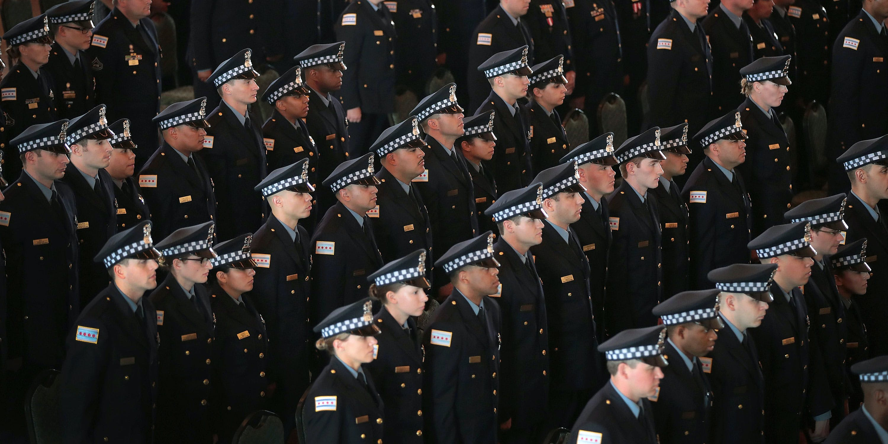 Chicago police officers attend a graduation and promotion ceremony in the Grand Ballroom on Navy Pier on June 15, 2017 in Chicago, Illinois. (Photo by Scott Olson/Getty Images)