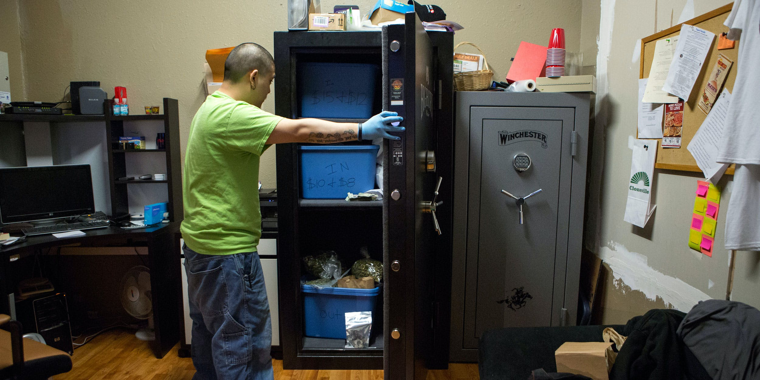Brendon, the manager of the cannabis store 'A Greener Today,' stores cannabis in safes in the store's backroom on March 14, 2014 in Seattle, Washington. Because federal laws still prohibit the sale of cannabis, stores don't have access to a legal cannabis banking system.