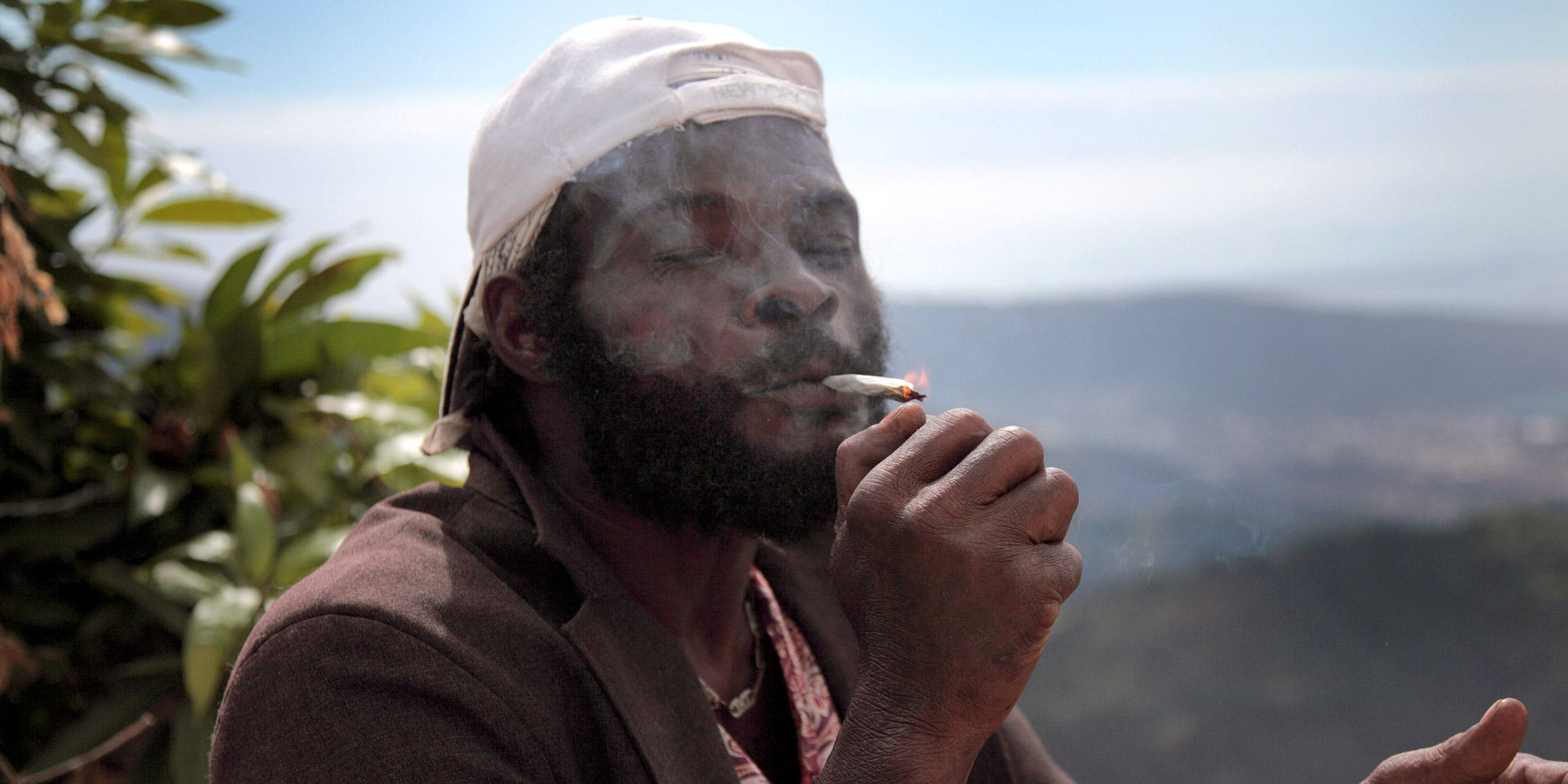 A man in Jamaica smokes weed. Jamaica is one of the five countries most likely to legalize cannabis in the near future.