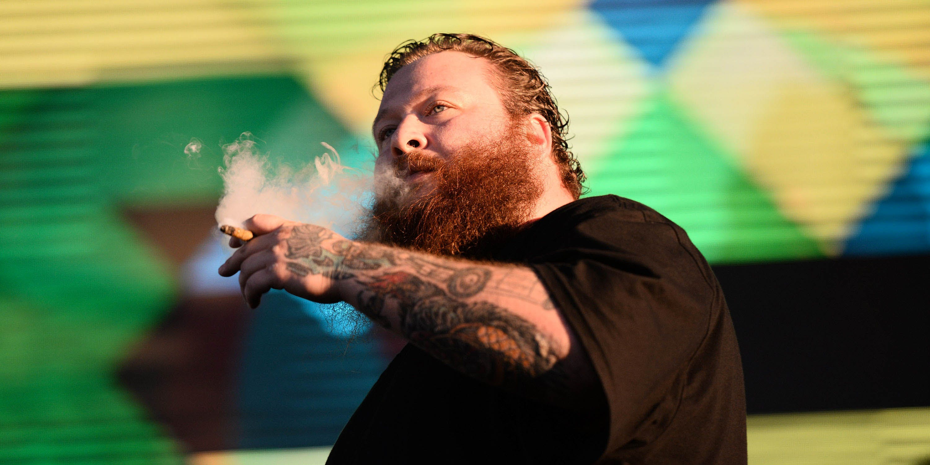 LOS ANGELES, CA - NOVEMBER 08: Rapper Action Bronson smokes a blunt onstage at the 3rd Annual Camp Flog Gnaw Carnival at the Los Angeles Coliseum on November 8, 2014 in Los Angeles, California. (Photo by Scott Dudelson via Getty Images)