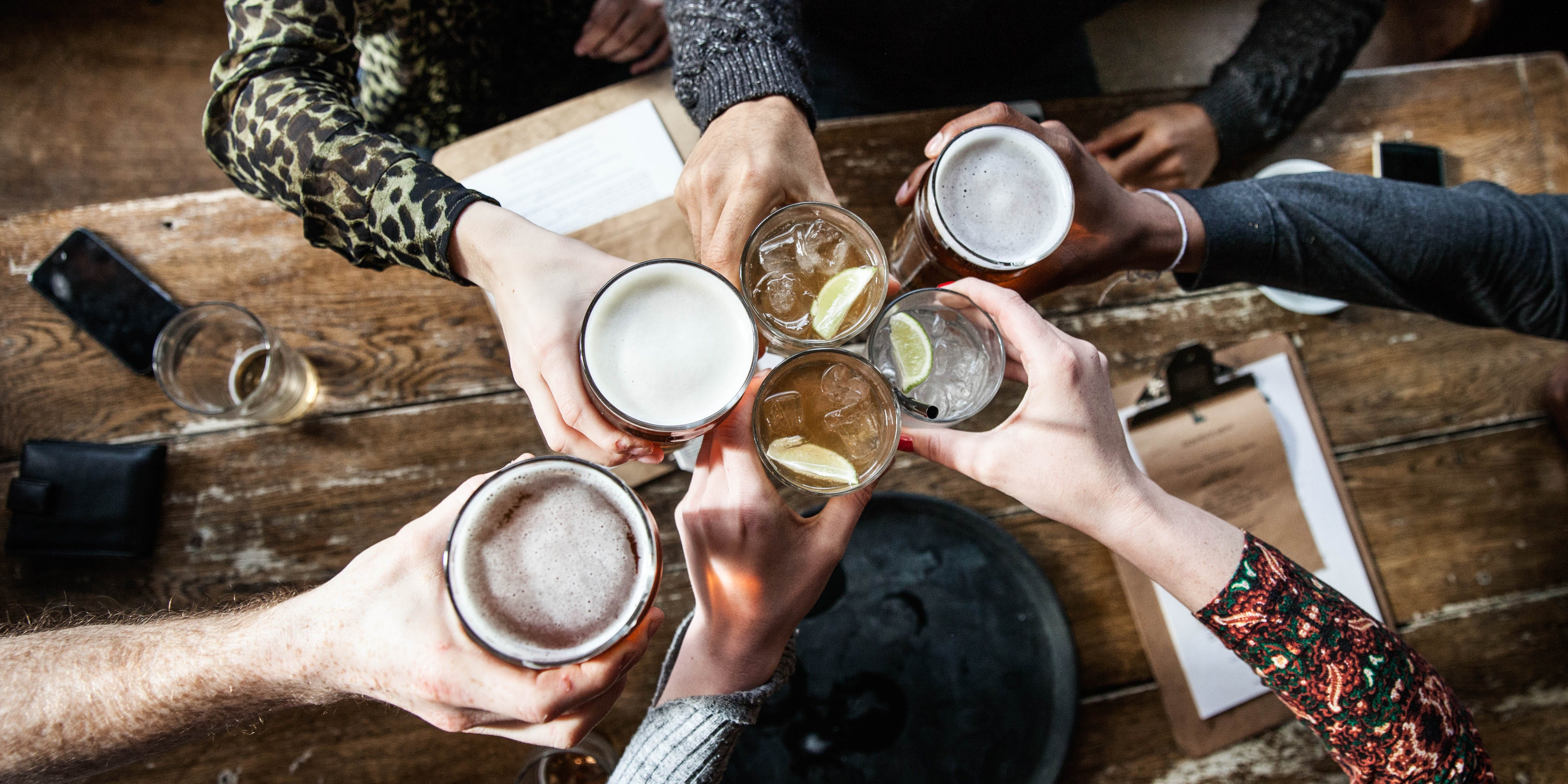 Coors Becomes the Latest Alcohol Company to Enter the Cannabis Industry. Here, friends are seen toasting with beers on tap