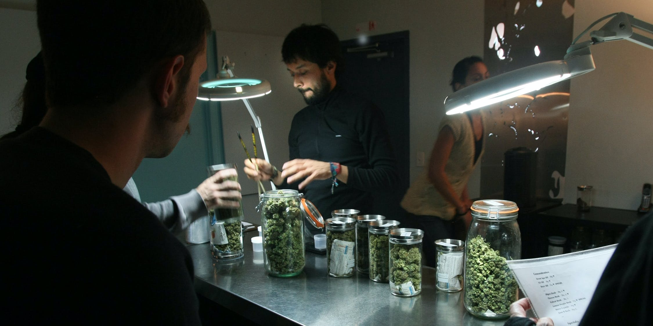 An associate at a medical marijuana dispensary in LA serves customers. In Colorado, it was recently revealed that, under a secret project, the state has been policing medical marijuana doctors for years.