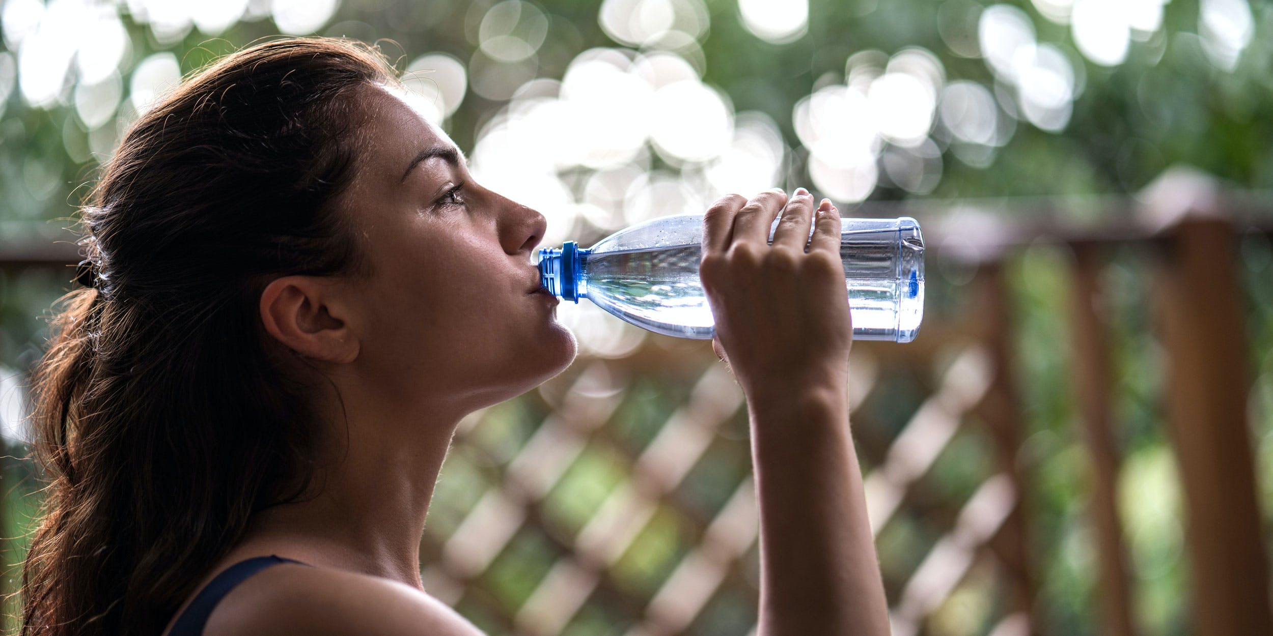 A woman drinks water, a common mistake for people who want to pass a THC urine test