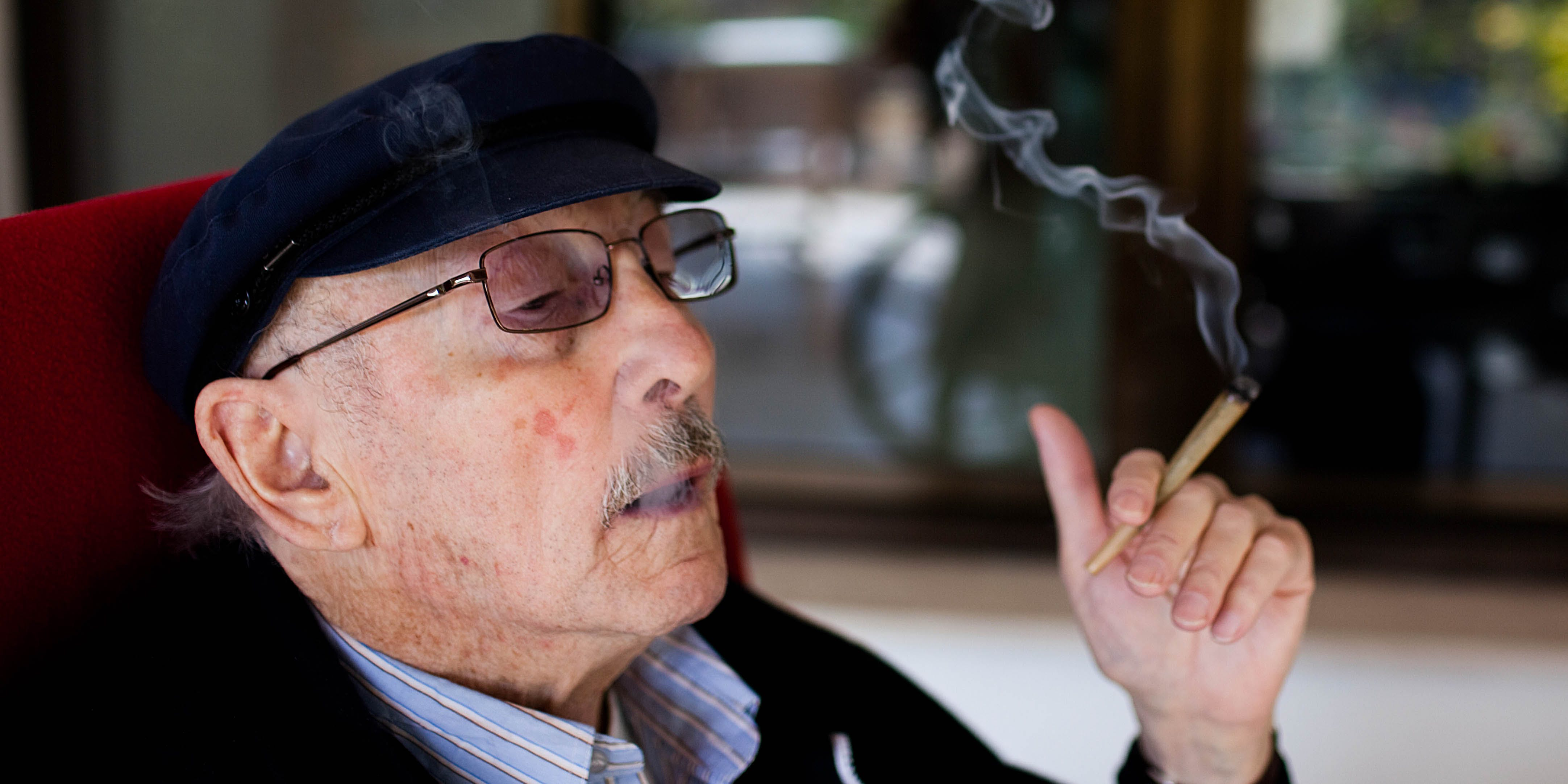 A man smokes cannabis at a nursing home in Israel. Most pain specialists are prescribing cannabis to patients to deal with pain.