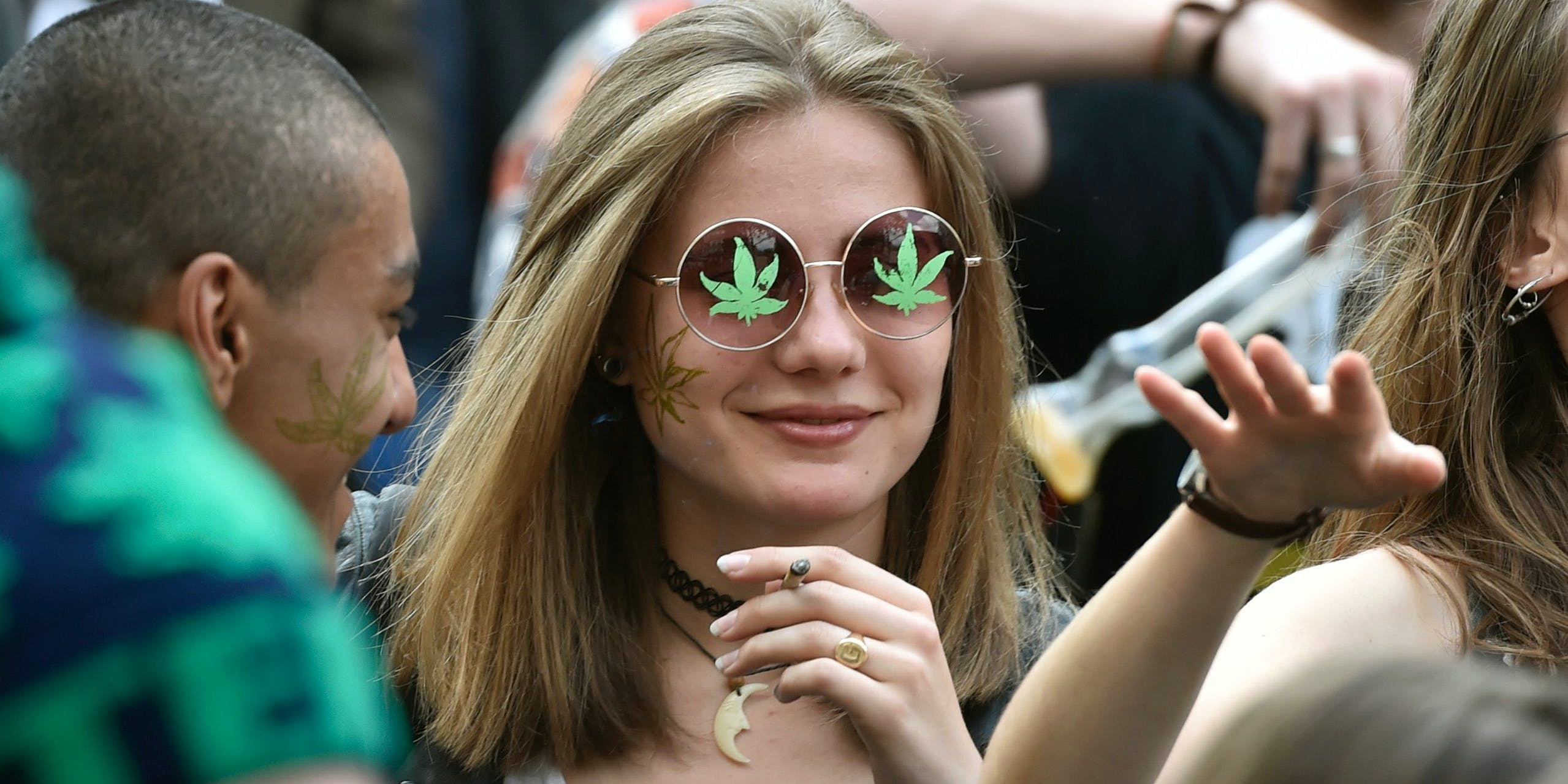 A young woman smokes in Paris on April 29, 2017, during the 16th annual Marche Mondiale du Cannabis to call for the legalization of cannabis. A recent survey found millennials smoke weed way more than their parents. (Photo by Alain Jocard/AFP via Getty images)