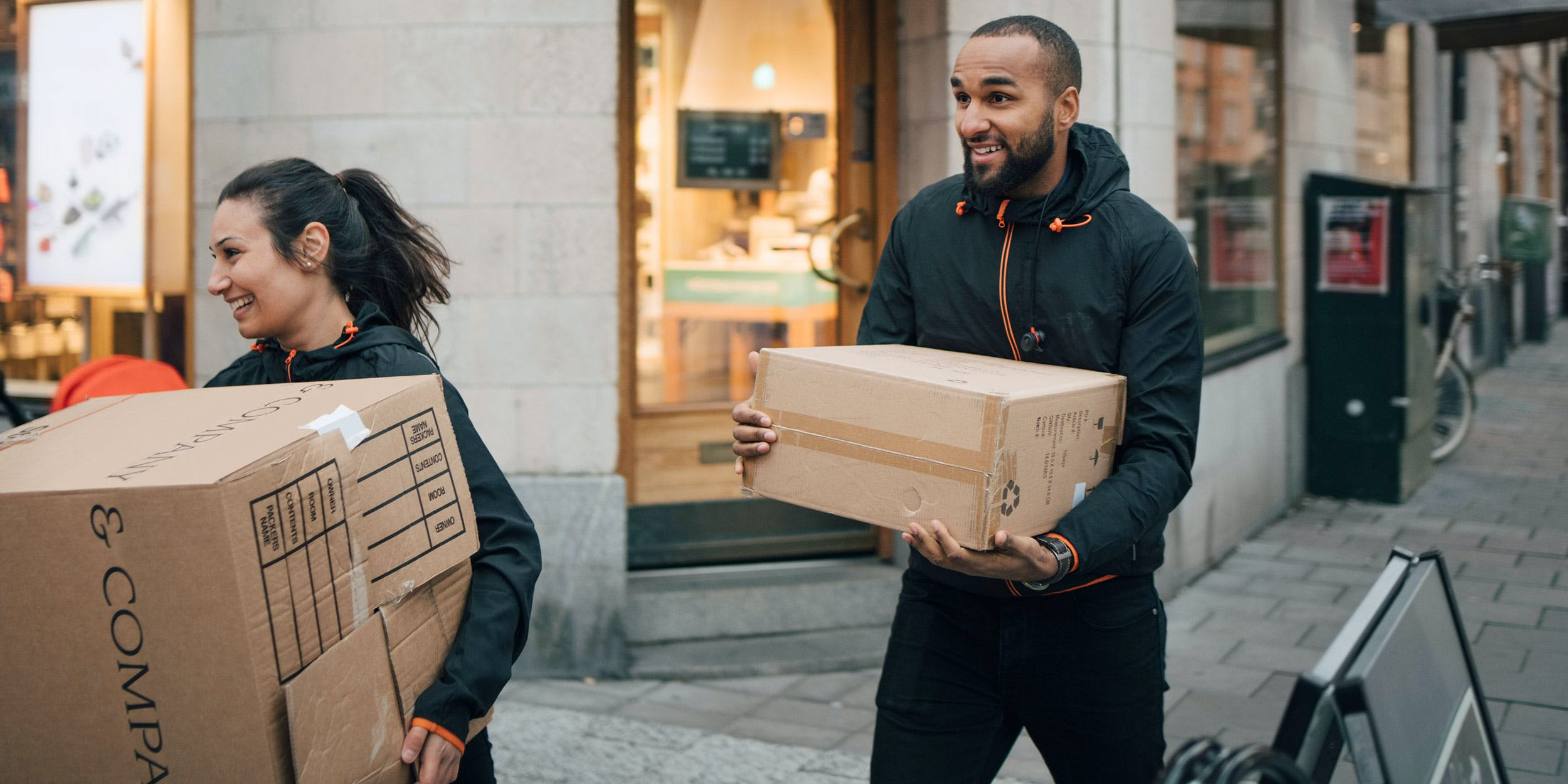 A man and woman putting packages into a van. In this article, Herb talks about a company that will mail you anxiety relieving CBD flower in all 50 states.