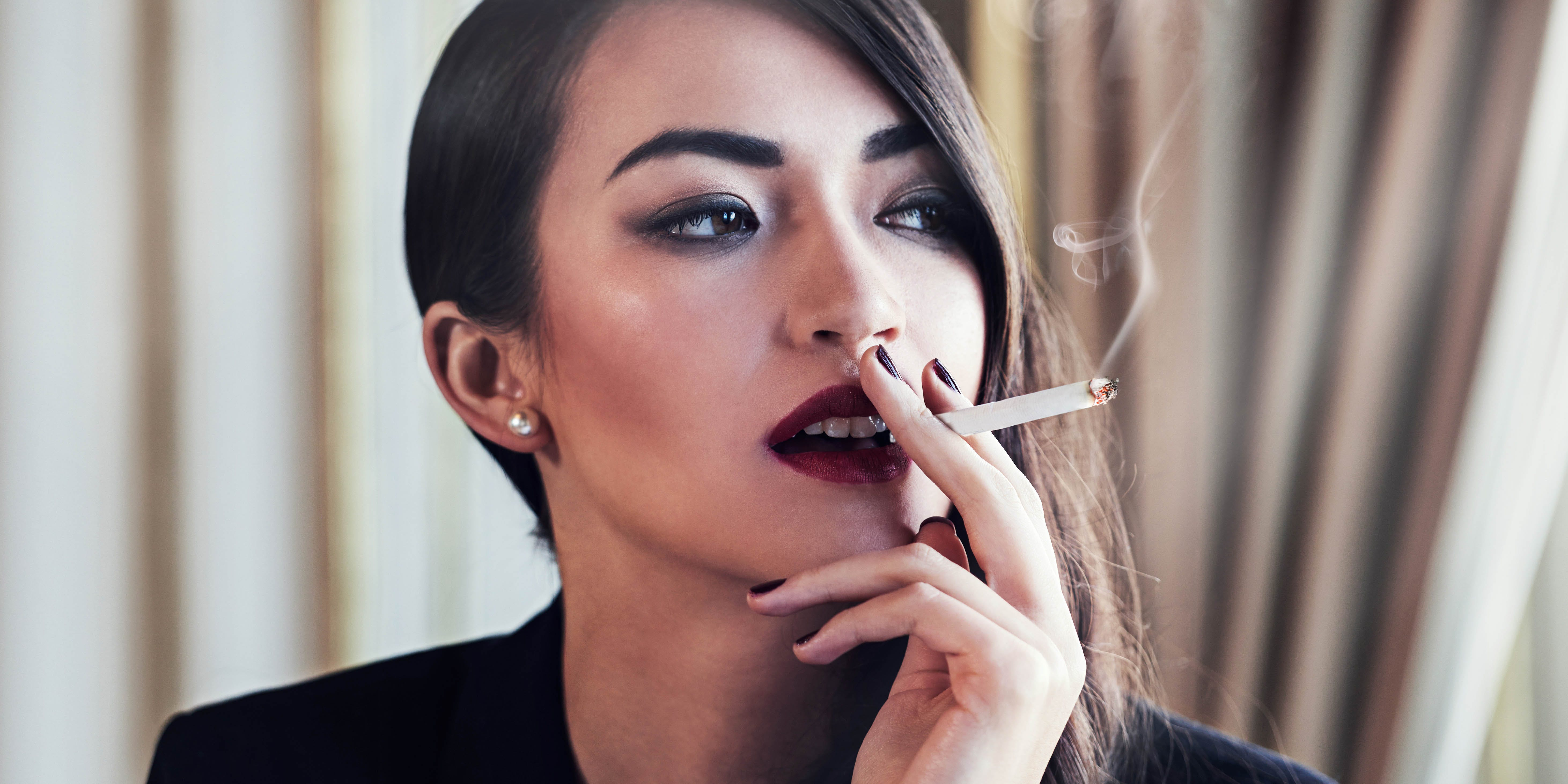 The Marijuana Show, aka the Shark Tank of Marijuana, is looking for the next weed millionaire. Here, we see a woman smoking a joint.
