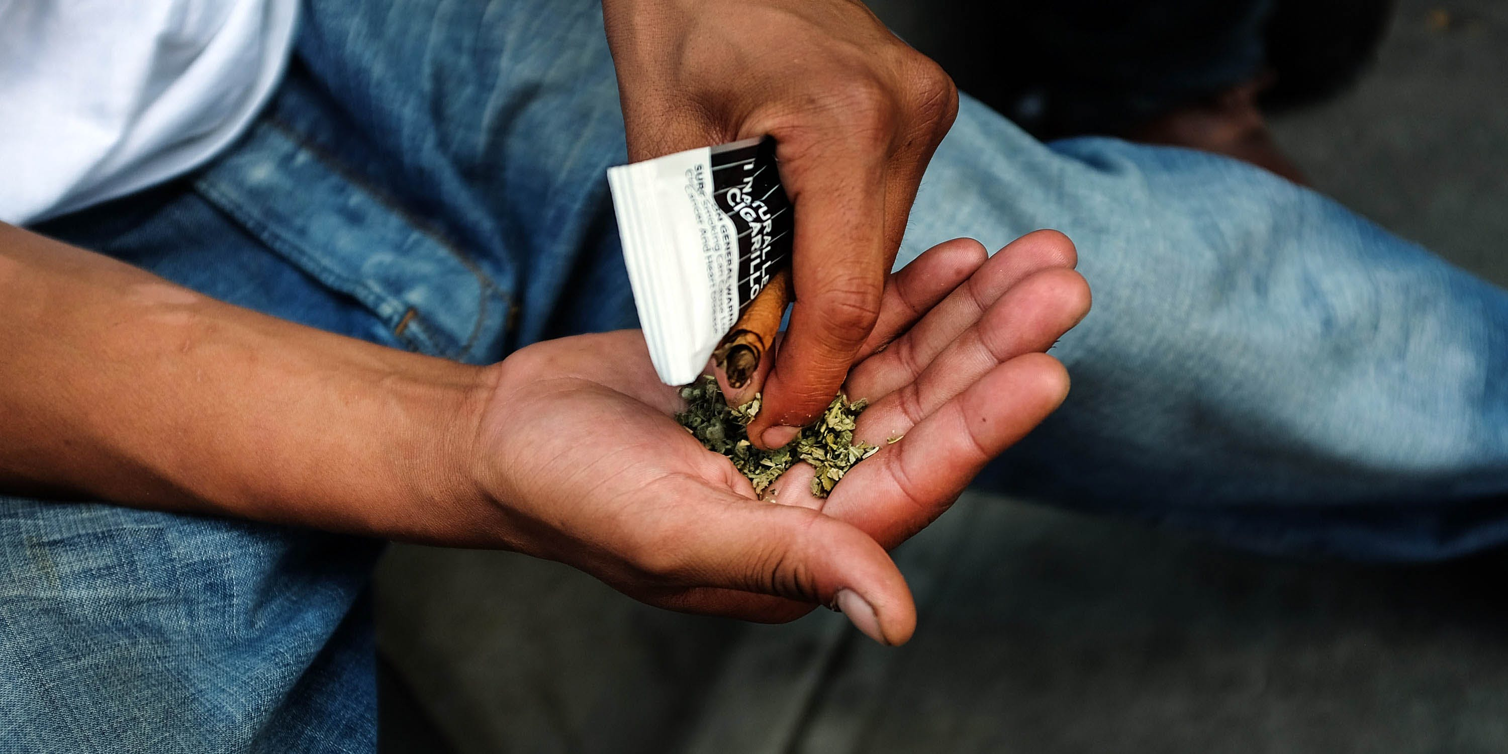 A man prepares to smoke synthetic cannabis in New York. In Wisconsin, however, the law is cracking down on anyone selling the dangerous substance.