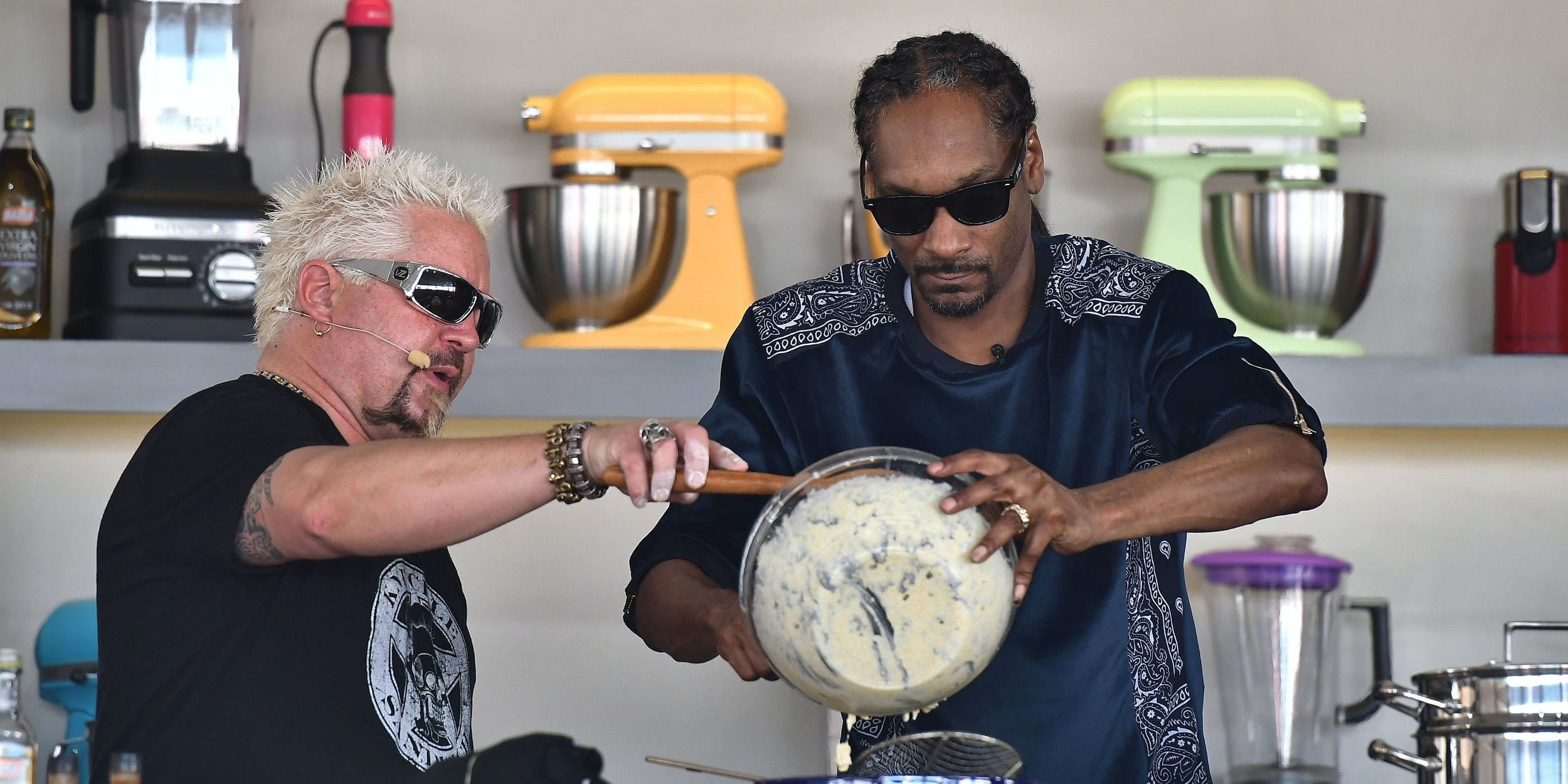 MIAMI BEACH, FL - FEBRUARY 25: Guy Fieri and Snoop Dogg cook on stage at Goya Foods' Grand Tasting Village on February 25, 2017 in Miami Beach, Florida. Snoop Dogg's cookbook will be available in stores on October 23. (Photo by Gustavo Caballero/Getty Images for SOBEWFF)