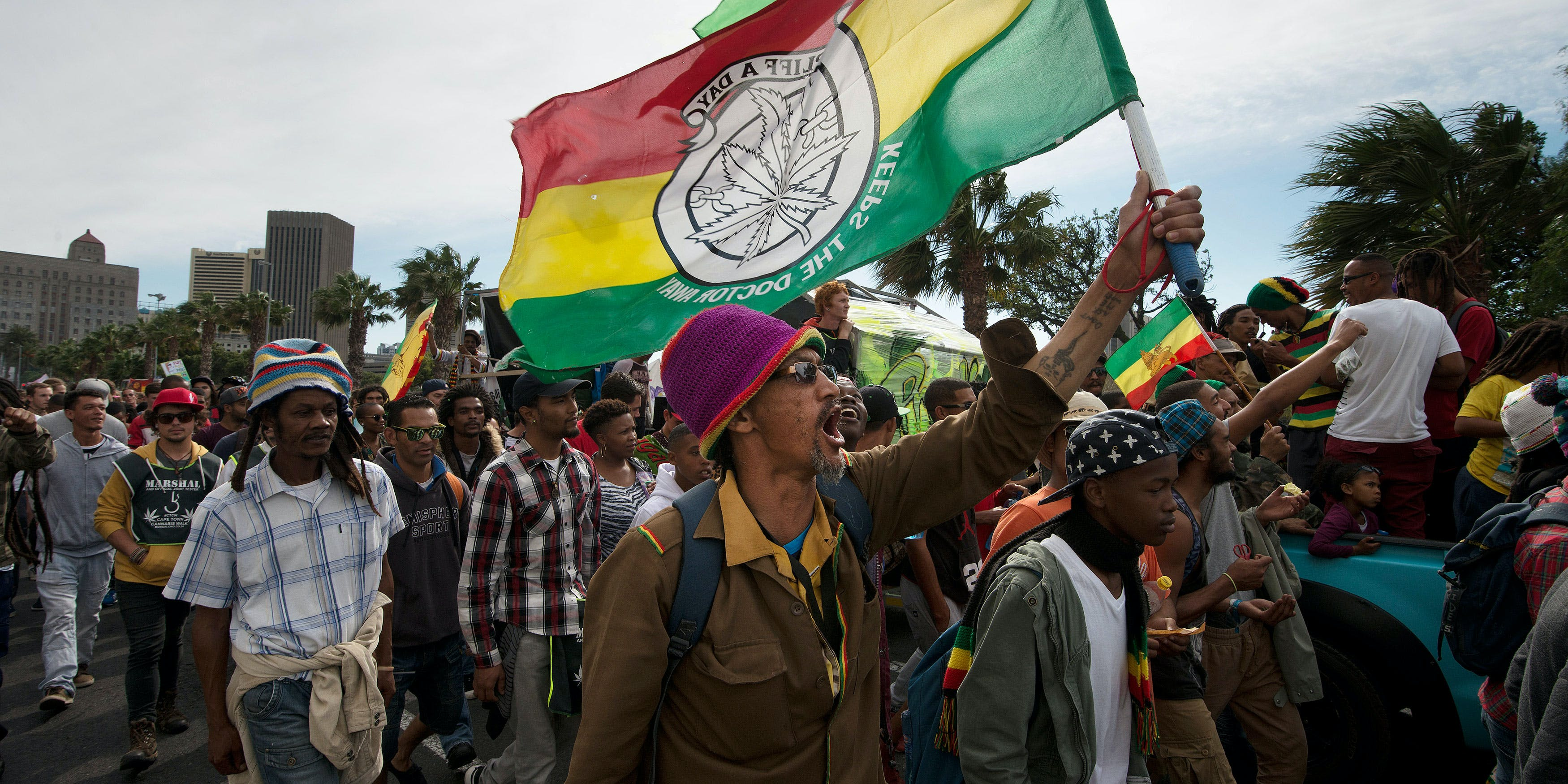 "Thousands of people take part in a march through the central city, calling for the South African government to legalize marijuana or cannabis (also called dagga locally) on May 7, 2016 in Cape Town. In this story, ""South Africa legalizes cannabis,"" we report on the decision of the country's highest court to permit cannabis use in the home for personal use. (Photo by Rodger Bosch/AFP/Getty Images)"