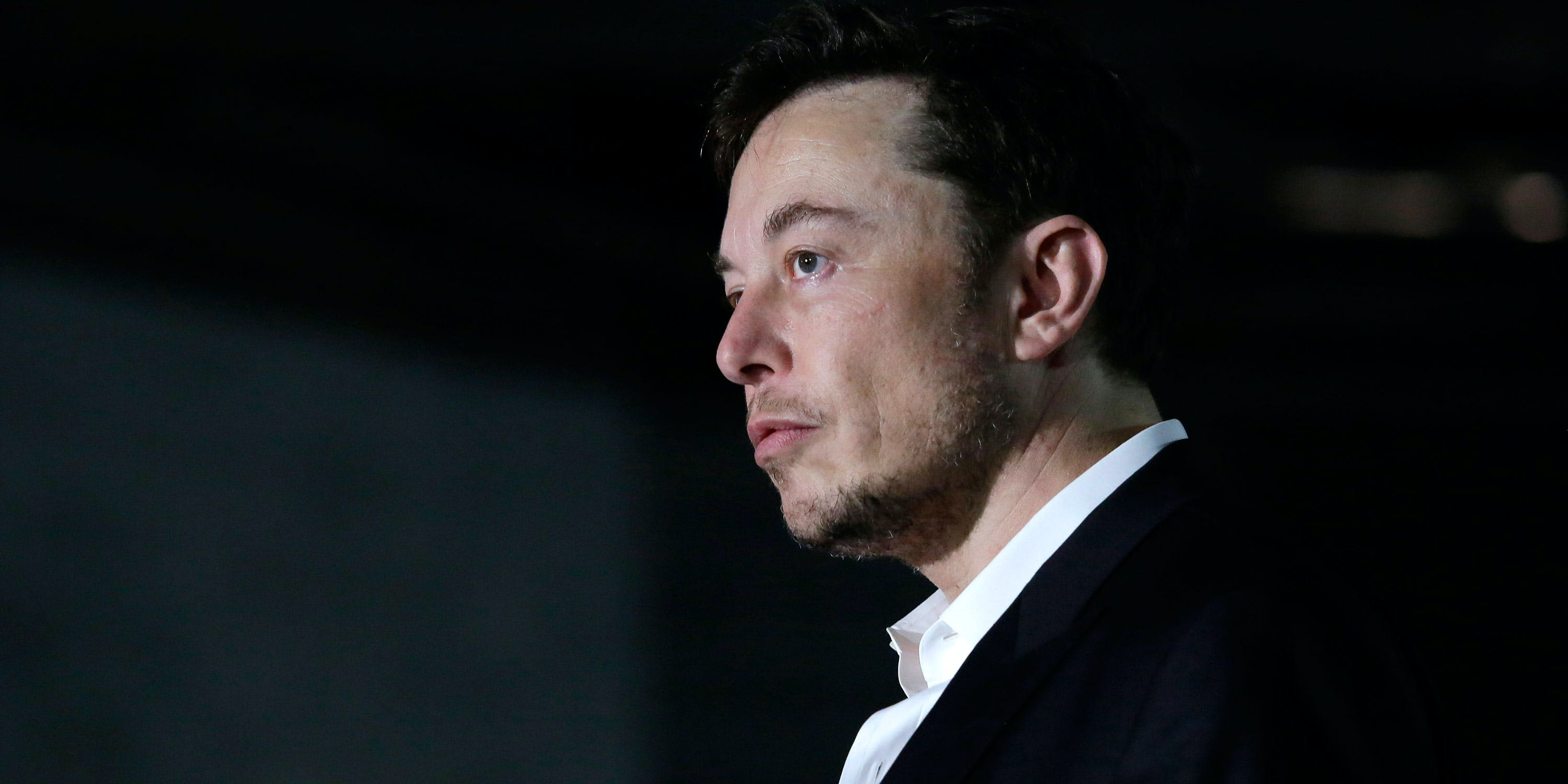 Engineer and tech entrepreneur Elon Musk of The Boring Company listens as Chicago Mayor Rahm Emanuel talks about constructing a high speed transit tunnel at Block 37 during a news conference on June 14, 2018 in Chicago, Illinois. Rumors surfaced last month that Elon Musk smokes weed, sparking concern among investors. After the rumors were confirmed on Friday, Tesla's stock plummeted. (Photo by Joshua Lott/Getty Images)