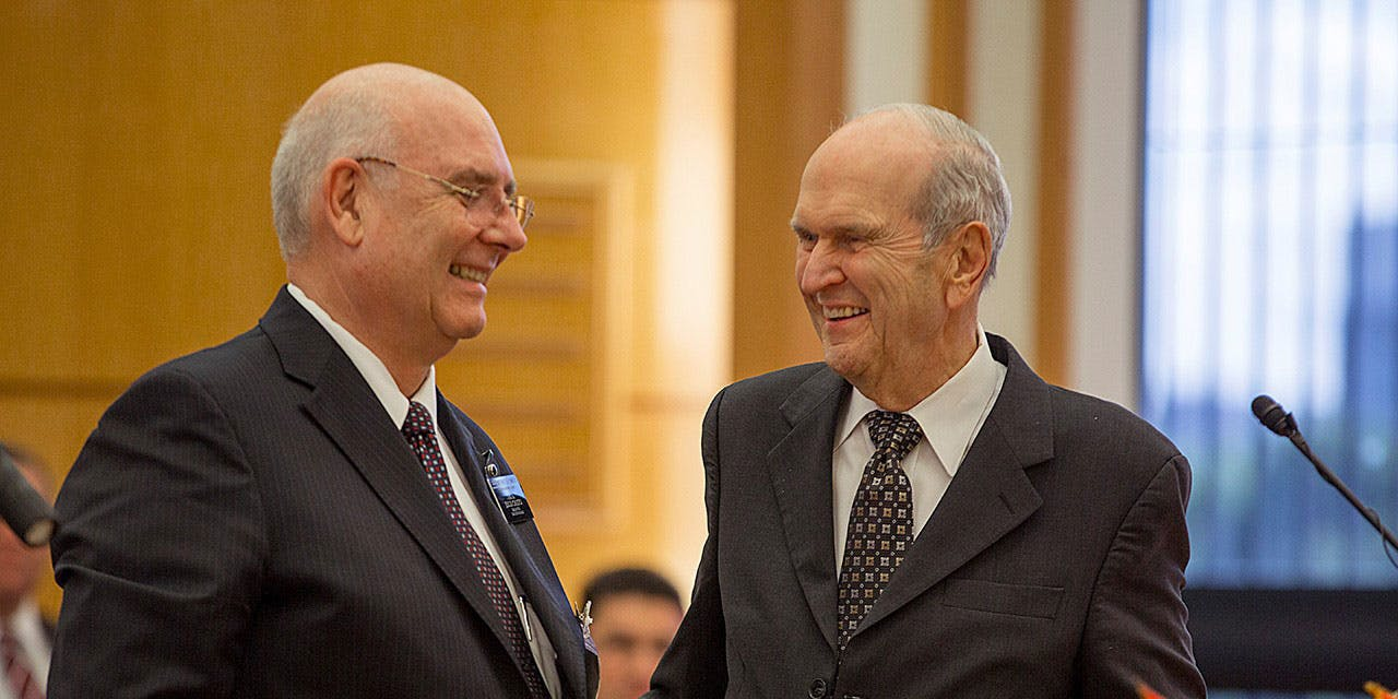 Elder Nelson speaks with Recife Mission President Rubens C. Lanius during a priesthood leadership meeting. The Mormon Church supports cannabis legalization in Utah, but not the bill that will go before voters in November.