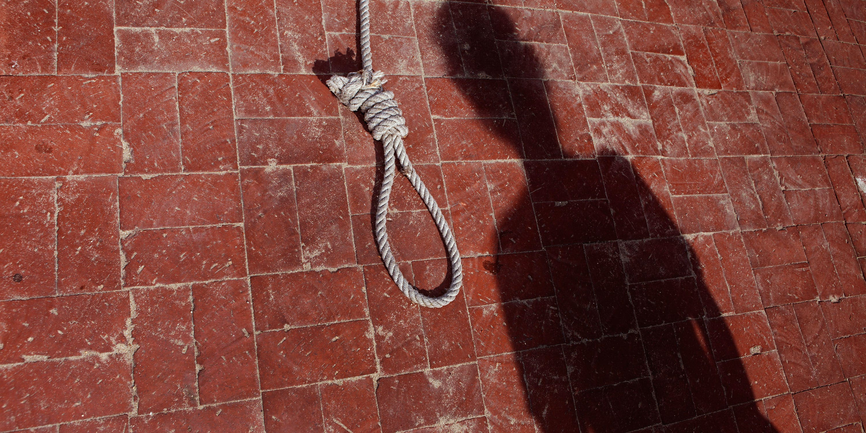 Malaysian Man Sentenced to Death for Cannabis Oil Given to Patients. Here, a shadow of a man is shown beside a noose