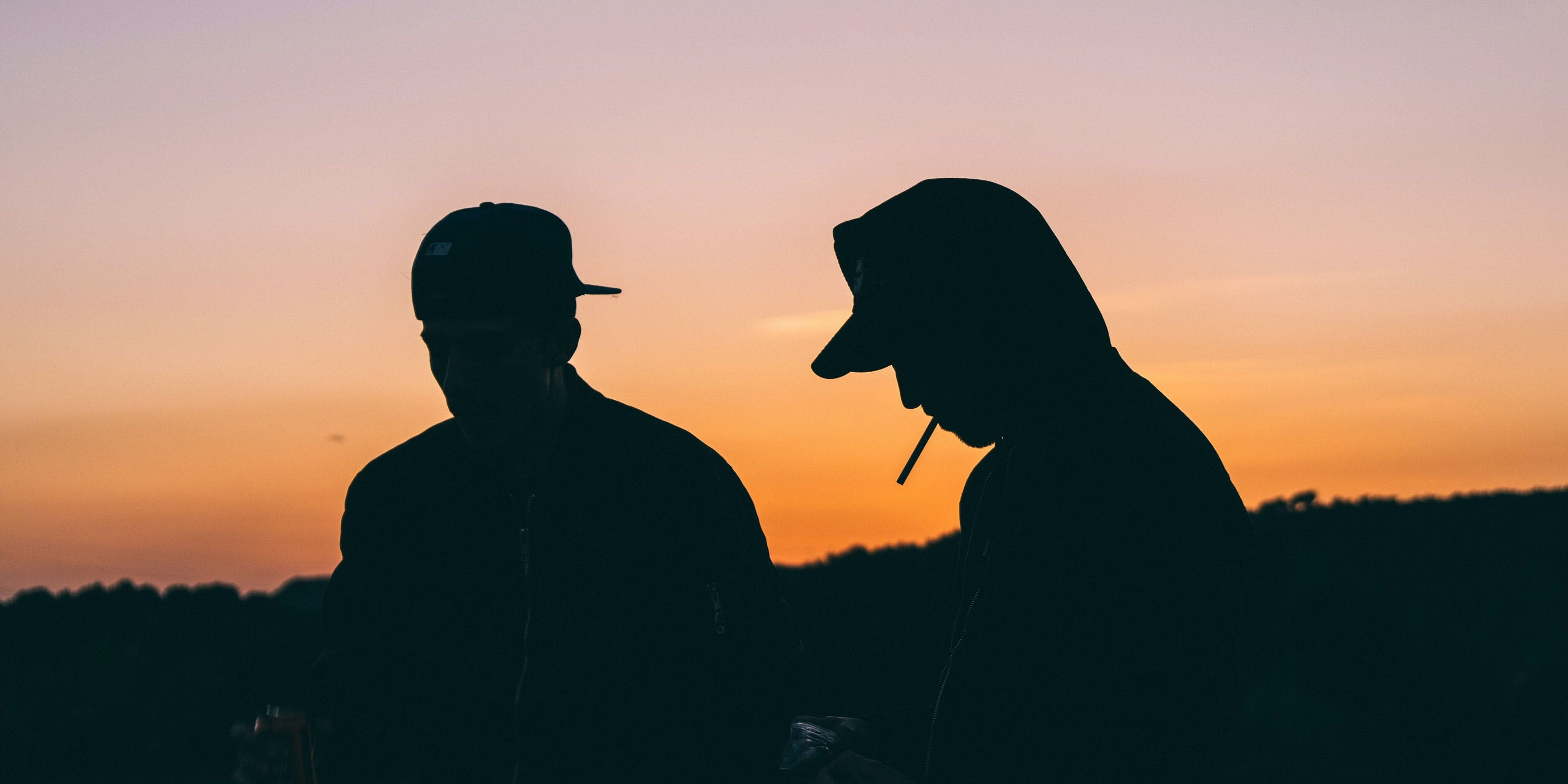 Most universities prohibit weed smoking on campus. Here, two students are shown smoking at sunset