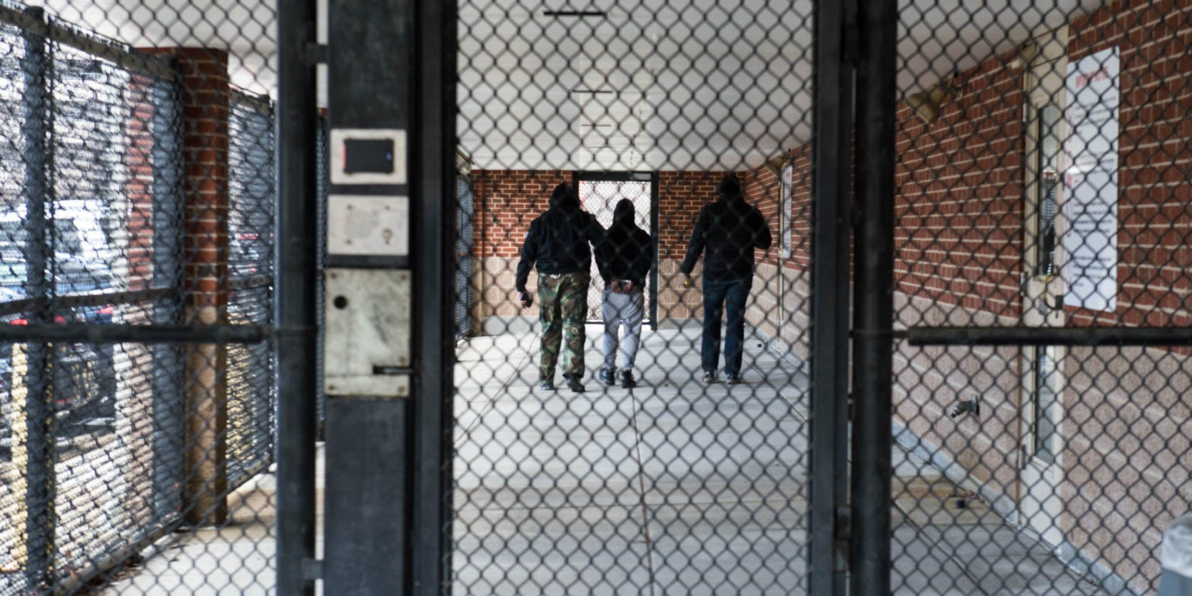 An inmate is escorted down the prison hallway. synthetic marijuana deaths in prison.