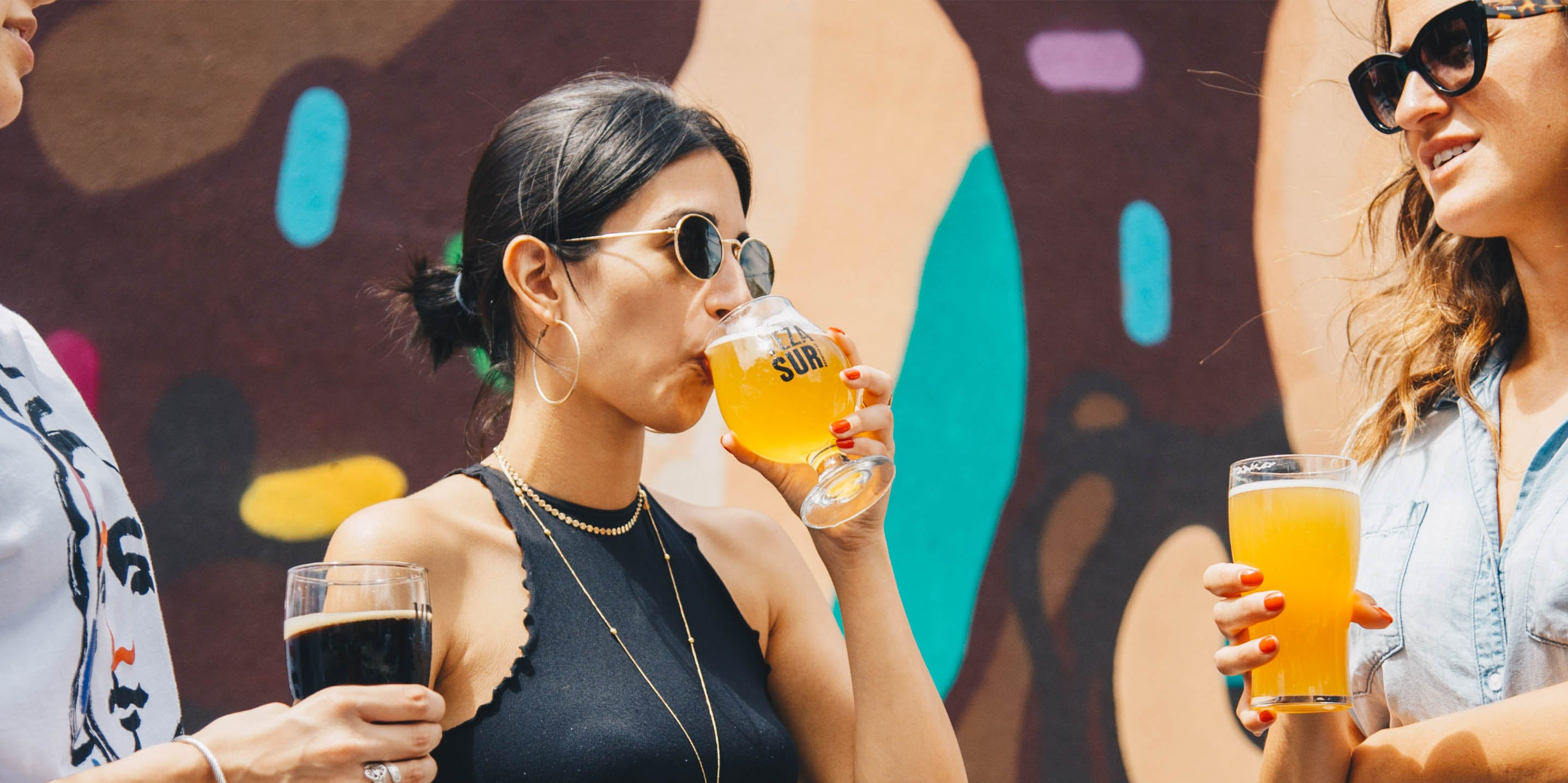 The Top 5 Cannabis Strains for Hangover Symptoms. Here, women are shown drinking beer
