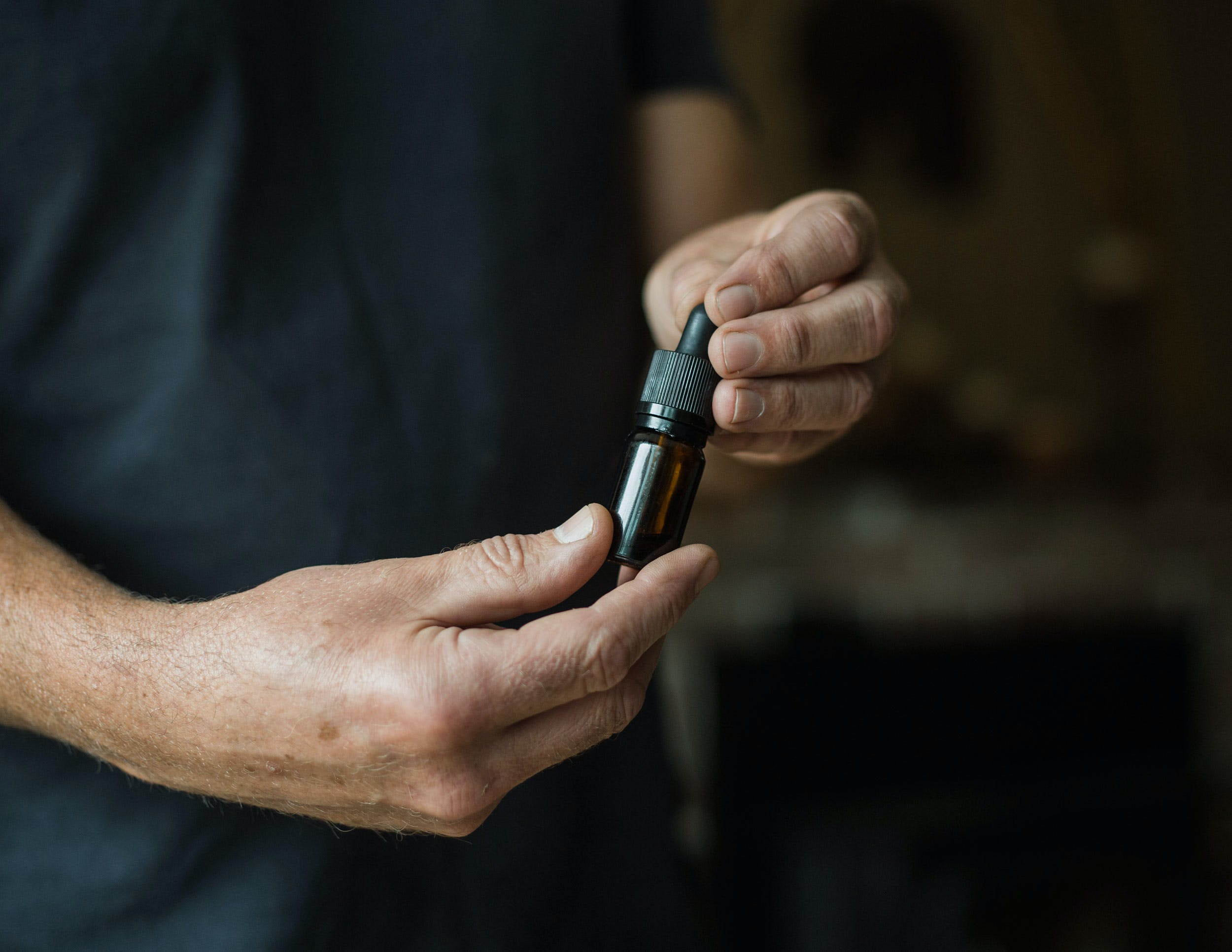tinctures are among The 5 Best Alternatives to Smoking Weed For Cannabis Users. Here, a man is shown w/ a tincture