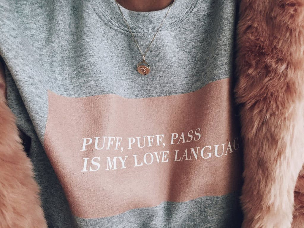 Weed Fashion That Says 'I Love Cannabis, But I'm Tasteful About It.' Here, the puff puff pass sweatshirt is shown