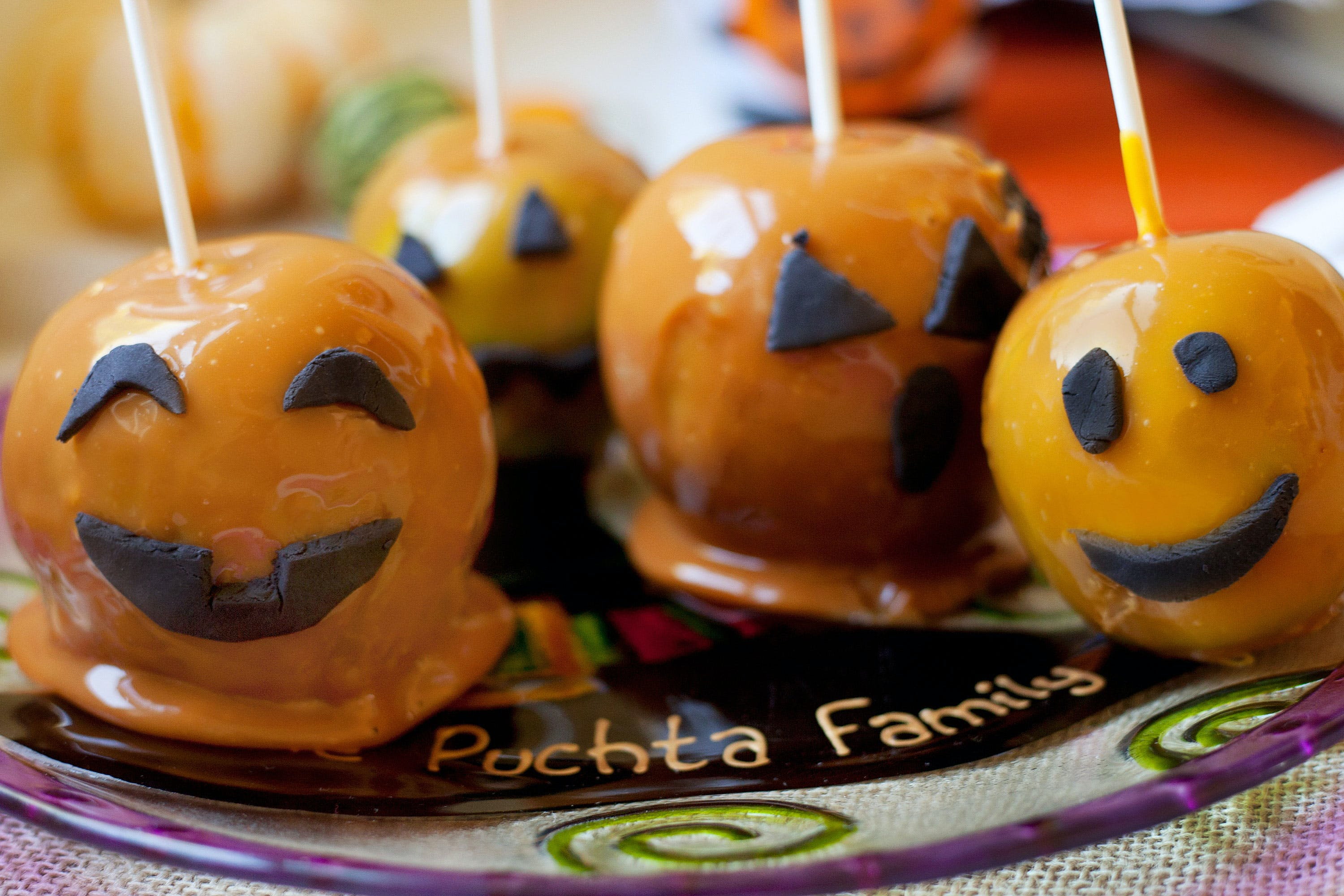Caramel apples are among the best halloween edibles. Here, apples decorated like jack-o-lanterns are shown