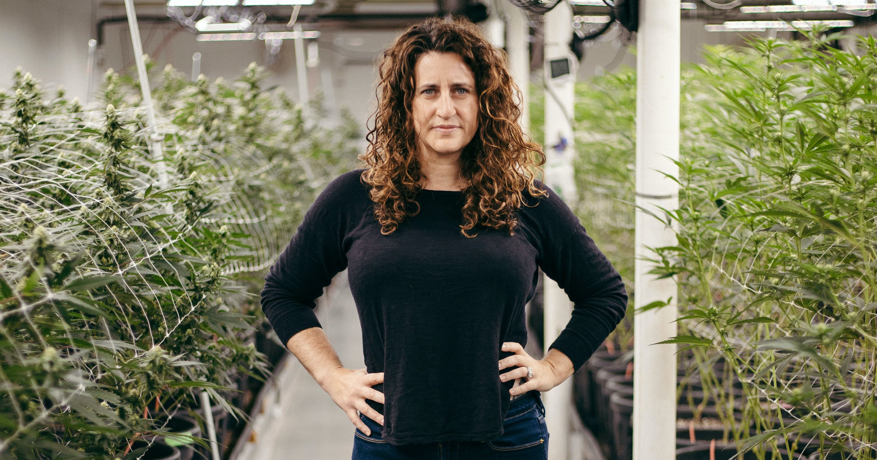 Amy Margolis stands in an indoor cannabis grow