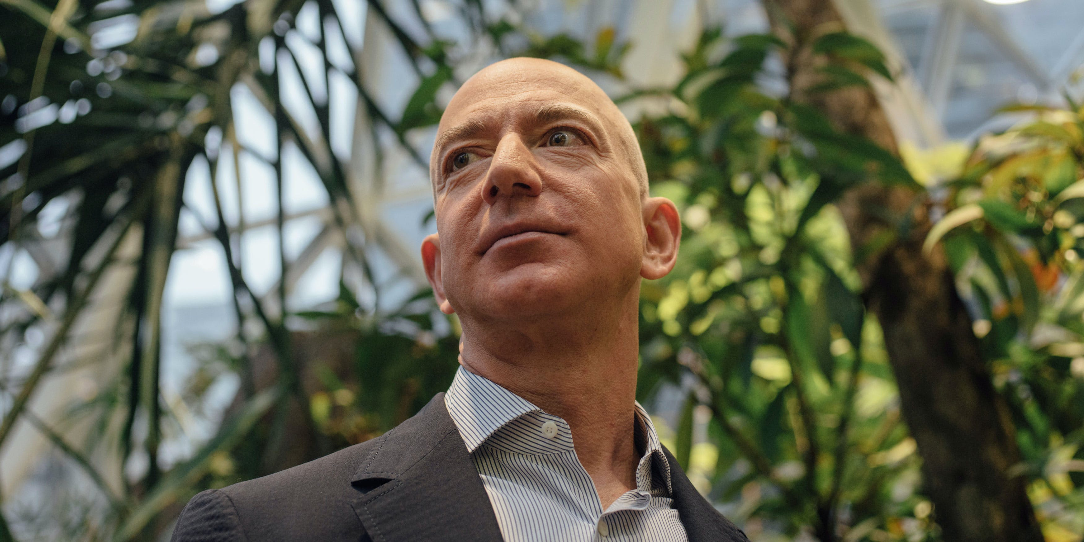 Amazon is donating money to NORML to legalize weed. Here, CEO and Founder Jeff Bezos is taken on a tour of the plants around The Spheres during the grand opening at the Amazon Spheres in Seattle, Washington on January 29, 2018.