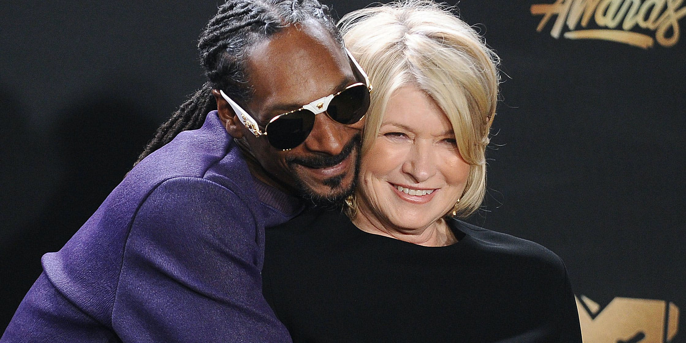 Longtime friends Snoop Dogg and Martha Stewart embrace. The duo recently released the Snoop Dogg and Martha Stewart Cookbook with tons of food cannabis enthusiasts will love.