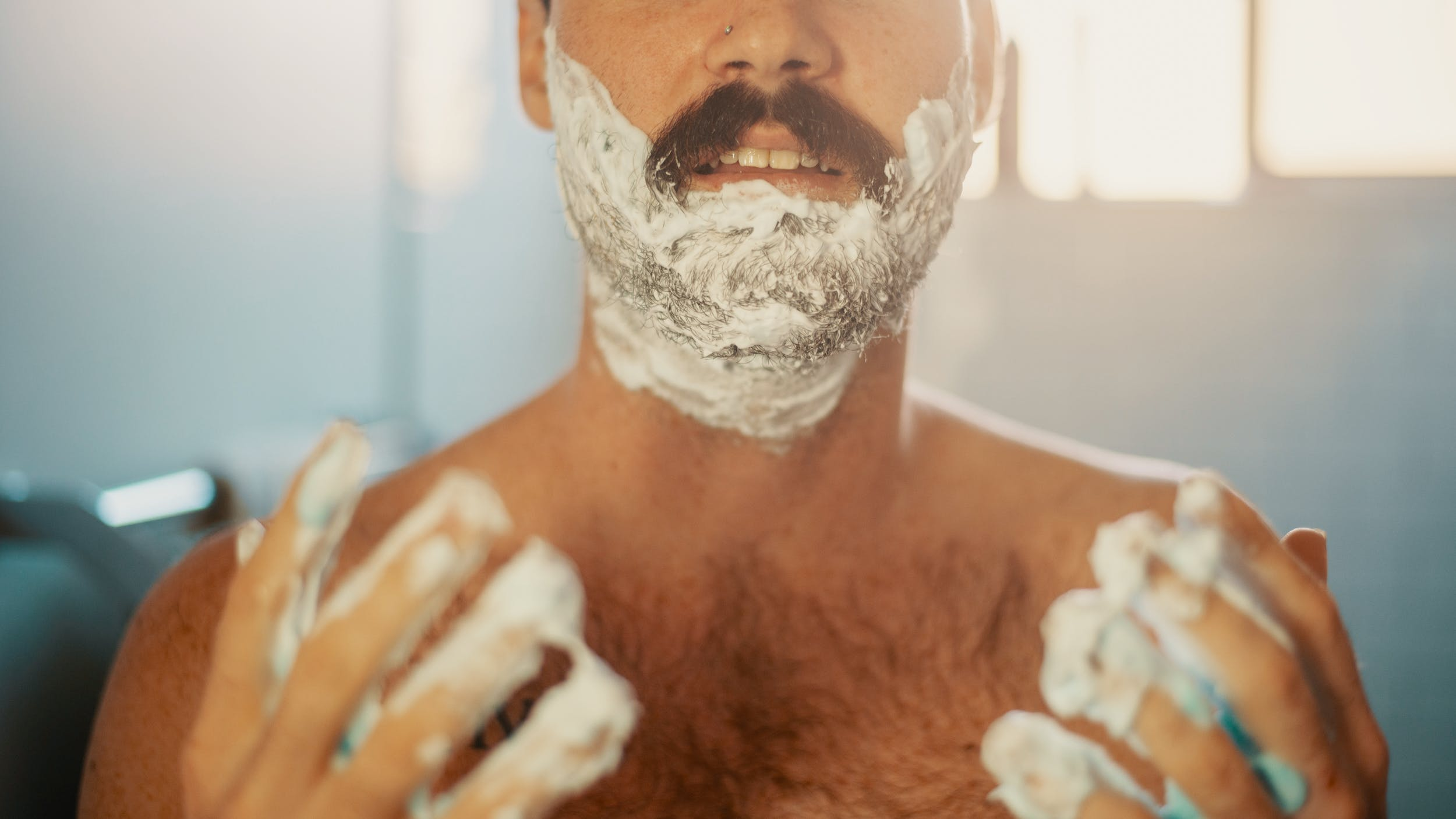 A man shaves using one of the products on the Herb holiday gift guide from Jack