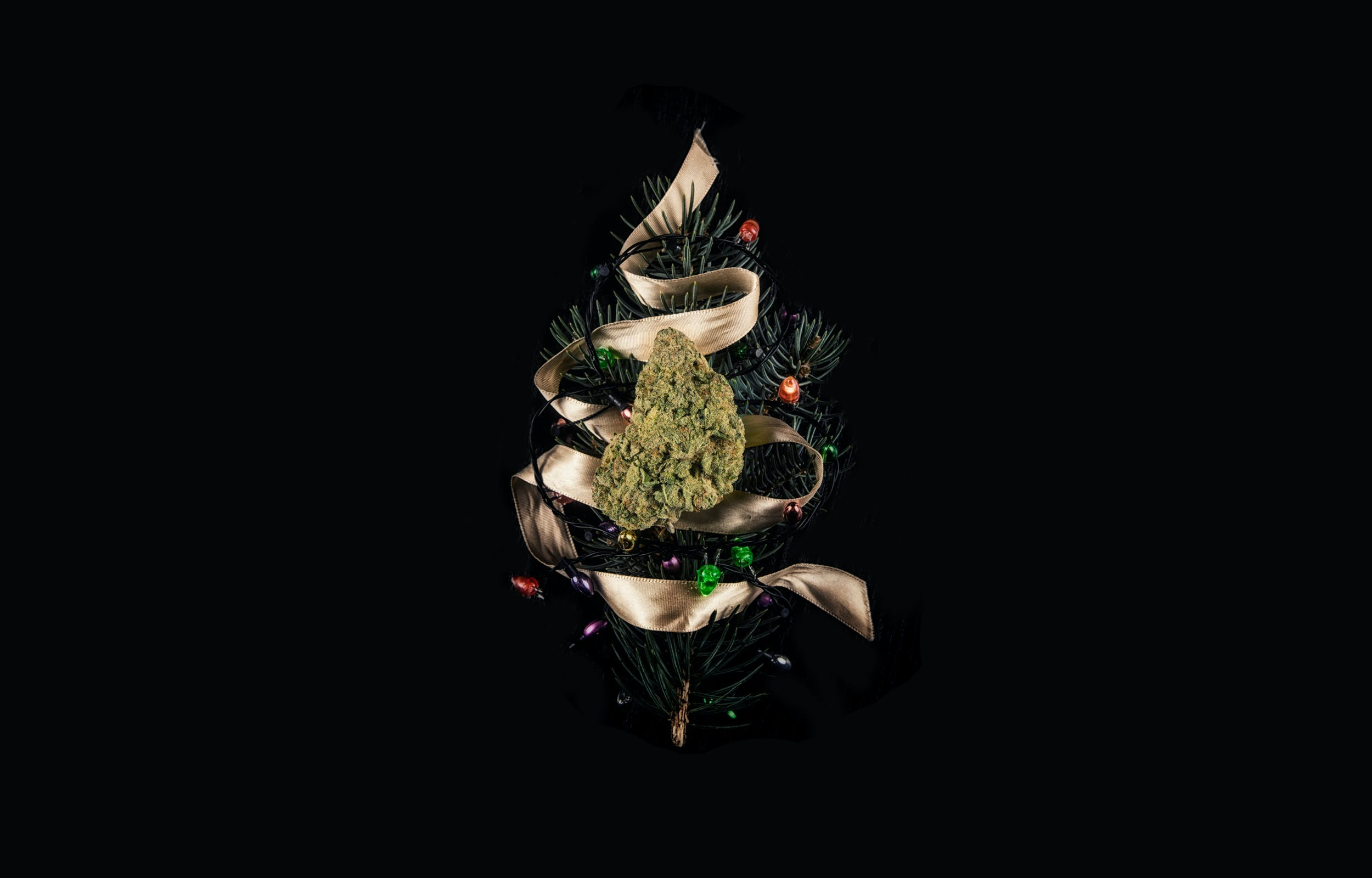 A weed nug wrapped in holiday ribbon to look like a Christmas tree for Herb's Holiday Gift Guide