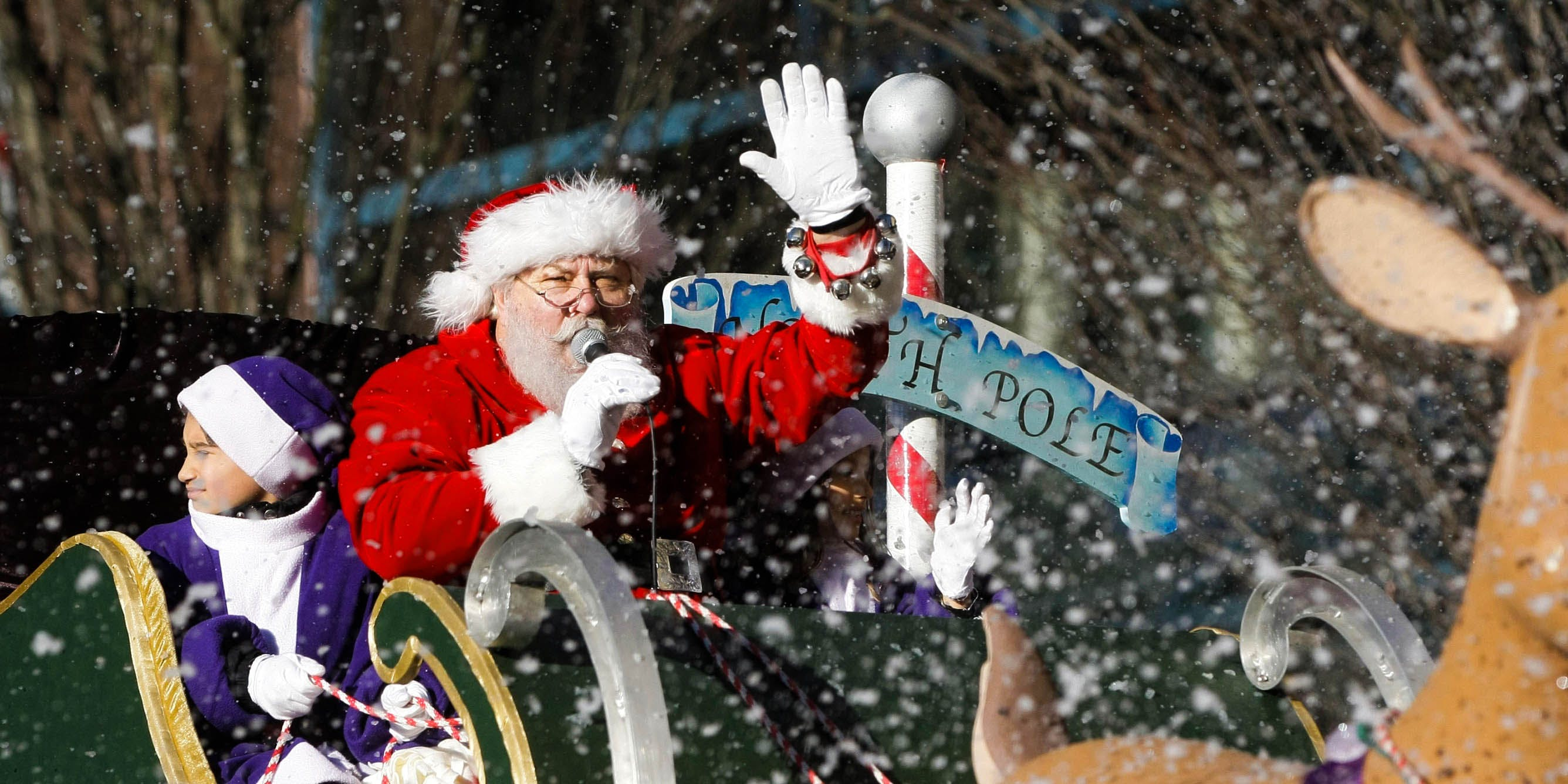 Santa Claus waves at the crowd from his float during the annual Vancouver Santa Claus Parade.
