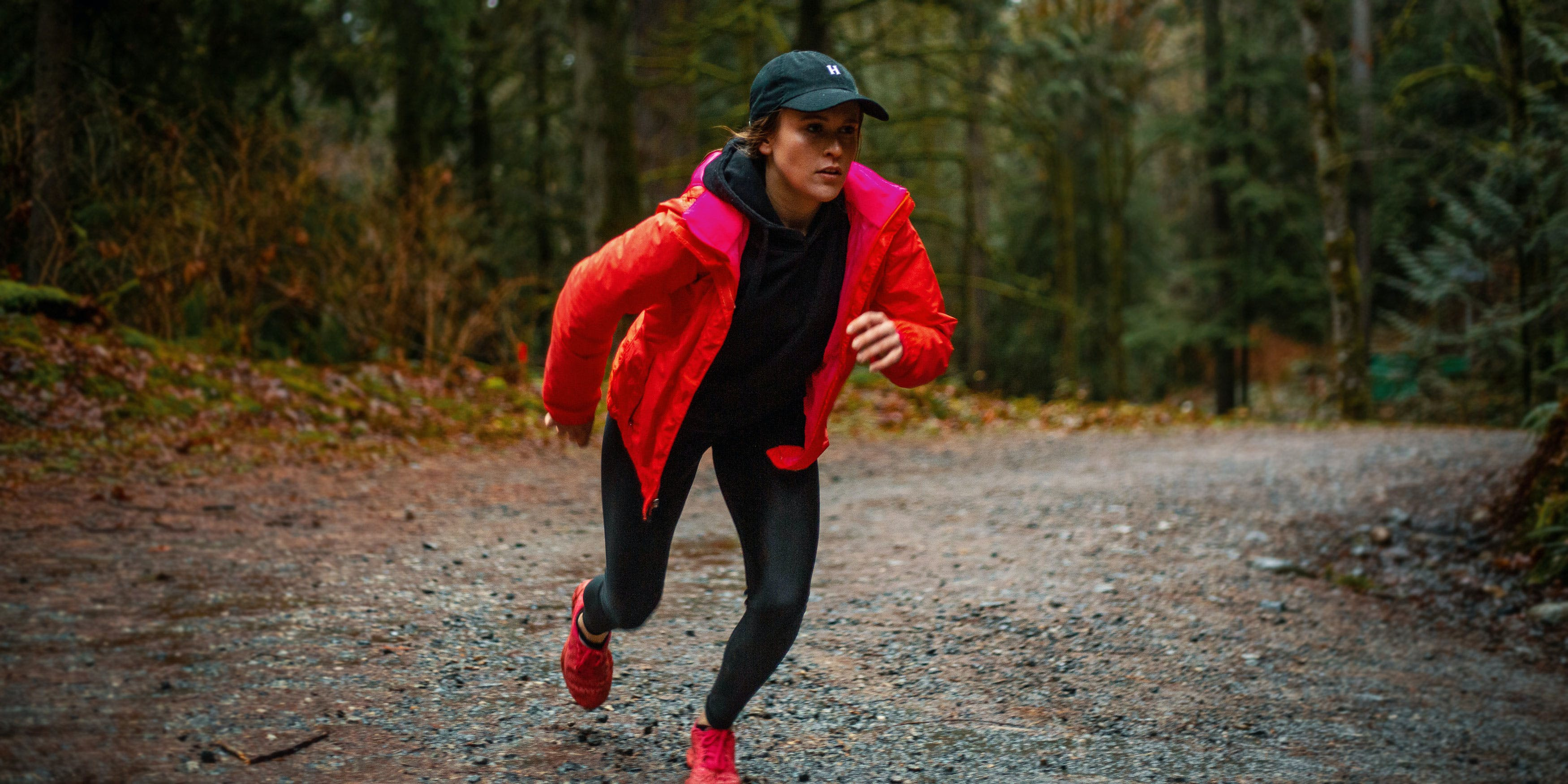 Smoking weed after working out: a woman jogs through the woods
