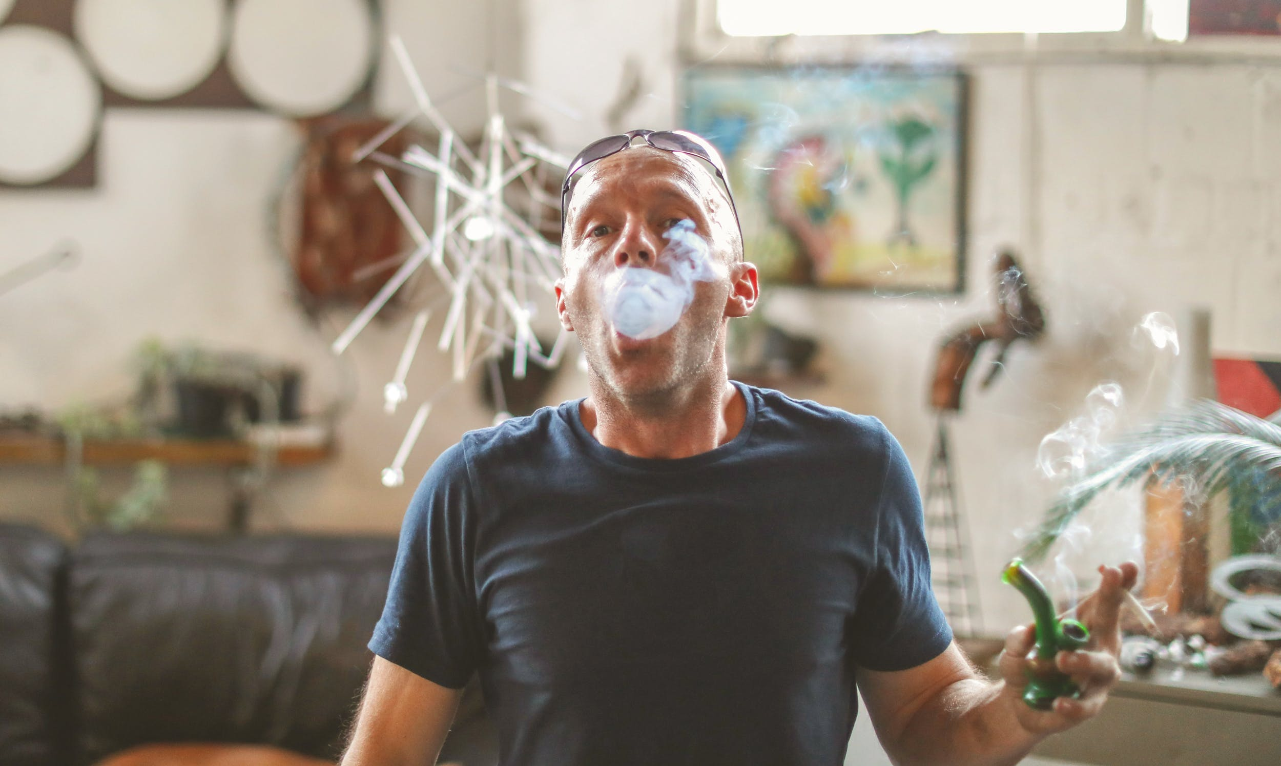 How to Make Dabs: A man exhales a massive cloud of smoke