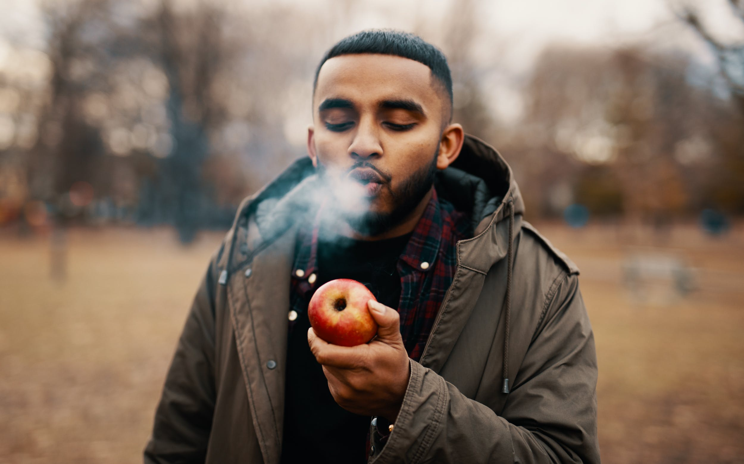 A man learns how to make an apple pipe with our how to make an apple pipe guide